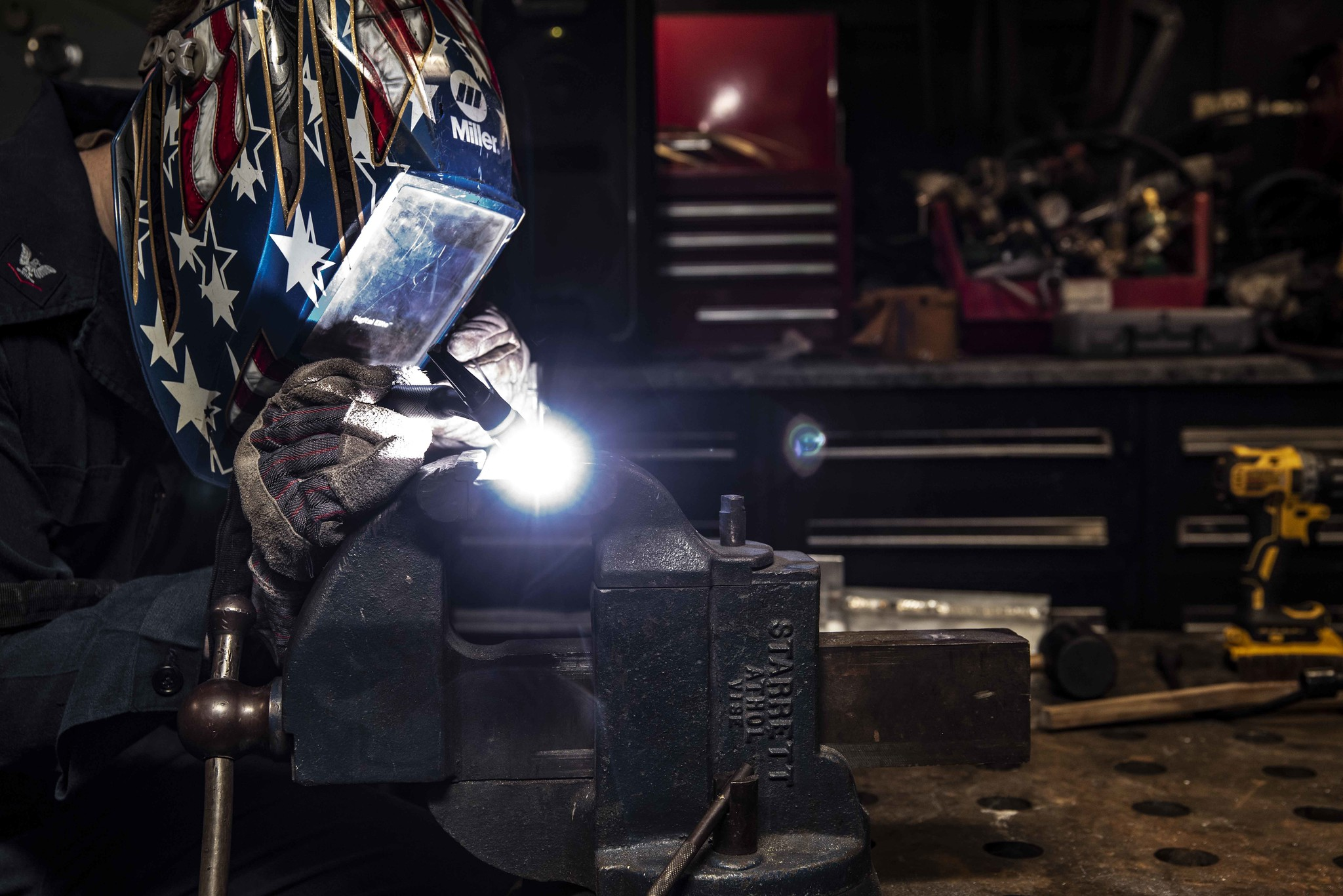 Hull Maintenance Technician 3rd Class Drew Knutson welds stainless steel and aluminum angles in the repair shop of the aircraft carrier USS Ronald Reagan (CVN 76) on July 8, 2020, in the South China Sea. (MC3 Jason Tarleton/Navy)