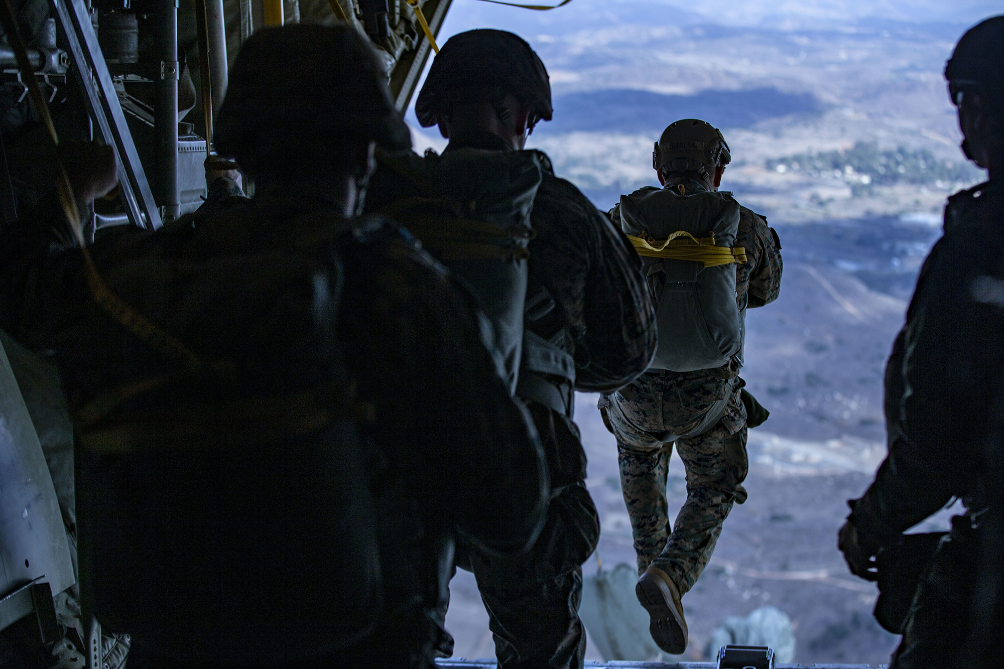 Marines static line jump from a KC-130J Hercules over Drop Zone Basilone during a parachute operation on Marine Corps Base Camp Pendleton, Calif., Dec. 10, 2020. (Lance Cpl. Drake Nickels/Marine Corps)