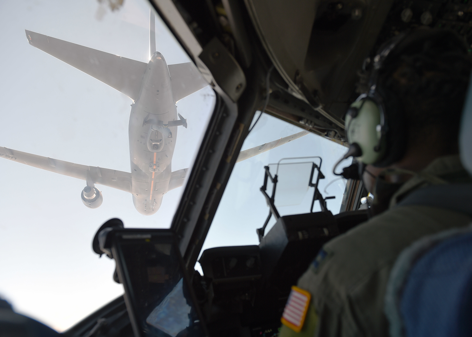 Capt. Edmond Duvall, 7th Airlift Squadron pilot, prepares to aerial refuel a C-17 Globemaster III from a KC-46 Pegasus from Fairchild Air Force Base, Wash., over Washington state, Aug. 5, 2020. The KC-46 Pegasus is the Air Force's newest refueling aircraft and many pilots are still learning and being certified on how to conduct refueling. (Airman 1st Class Mikayla Heineck/Air Force)