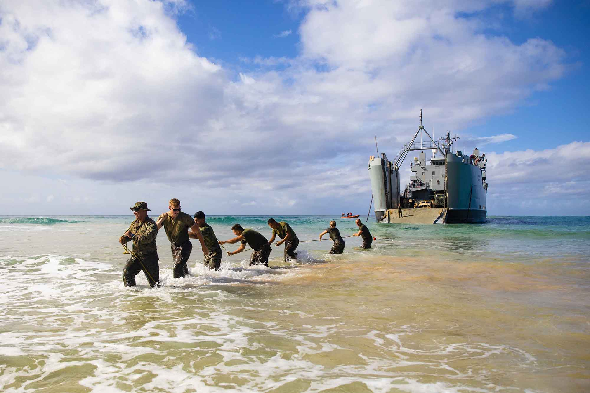 Marines pull a vehicle traction pad from a U.S. Army logistics support vessel during Exercise Spartan Fury 21.1, March 8, 2021, Major's Bay, Pacific Missile Range Facility, Kauai, Hawaii. (Lance Cpl. Brandon Aultman/Marine Corps)