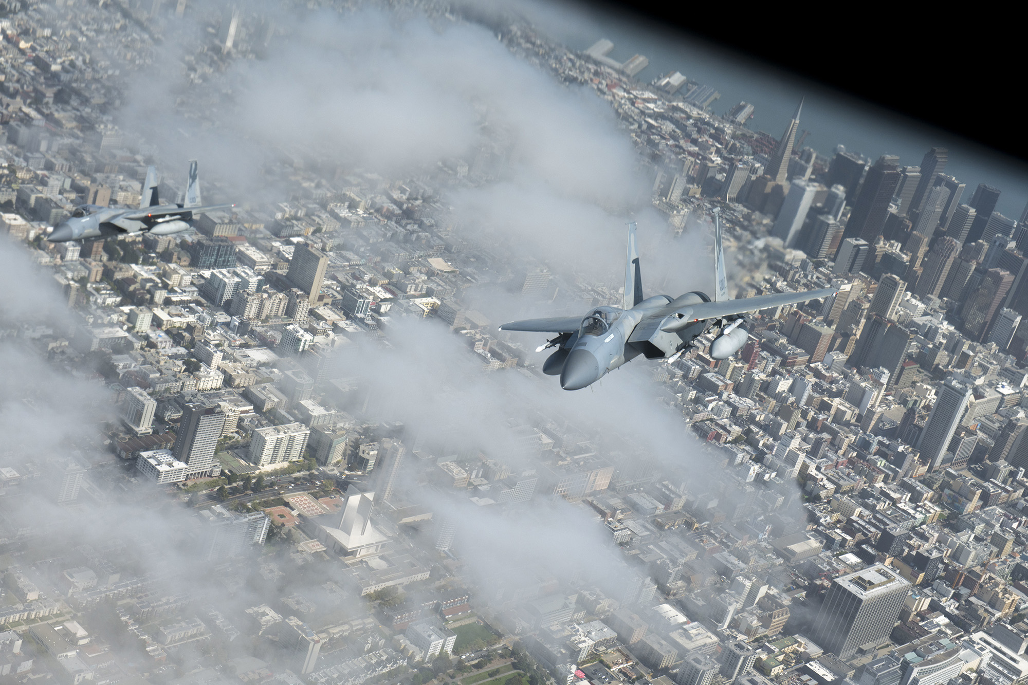 Two F-15C Strike Eagles fly in formation with a KC-135 Stratotanker during operation Noble Defender over San Francisco, April 6, 2021. Noble Defender simulated air defense of ports in California and North Carolina. (Senior Airman Lawrence Sena/Air Force)