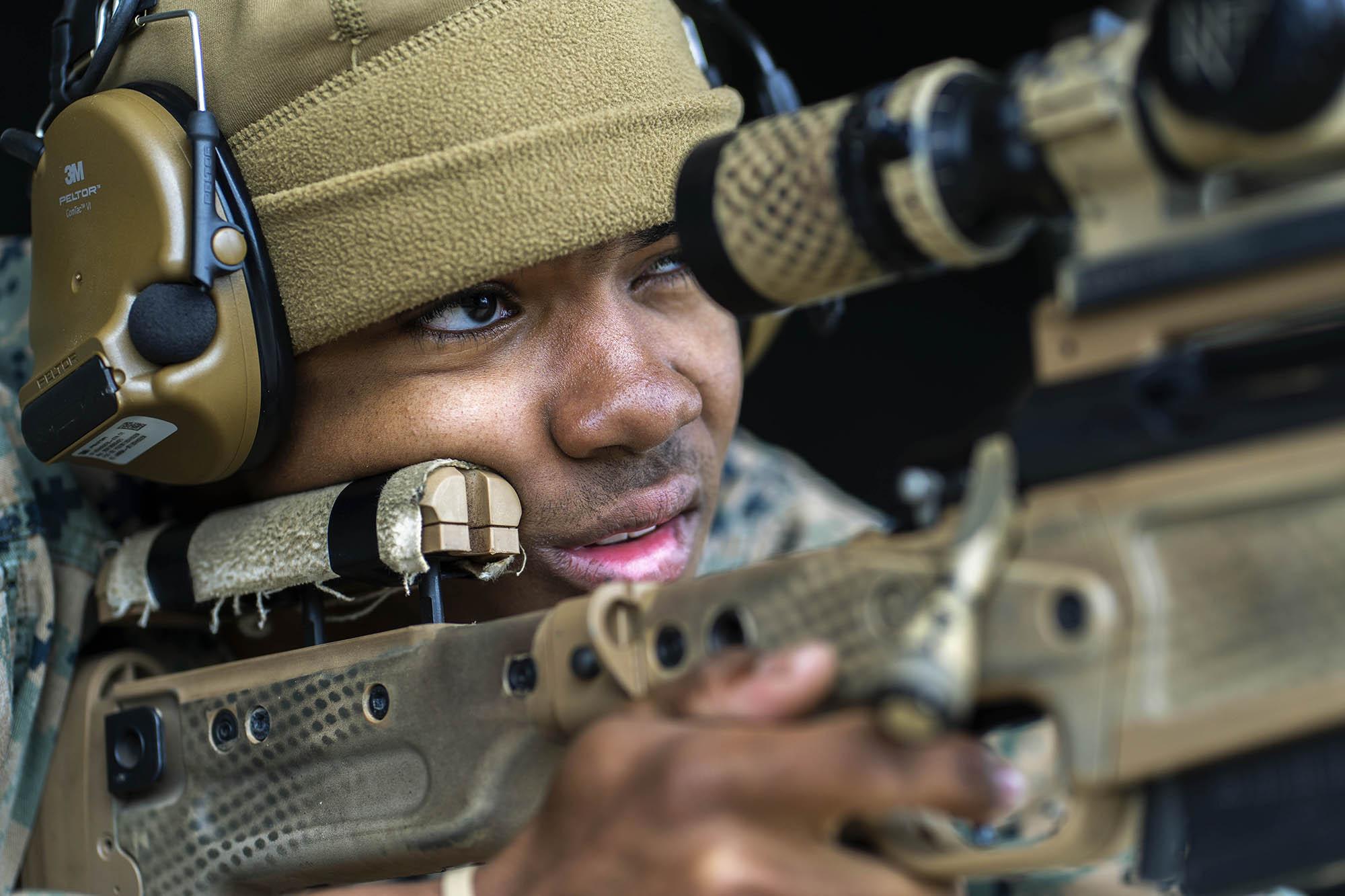 U.S. Marine Corps Lance Cpl. Jeremiah Riley-Caldwell fires an Mk13 Mod7 sniper rifle on Jan. 28, 2021, during a pre-sniper qualification course at Camp Hansen, Okinawa. (Lance Cpl. Juan Carpanzano/Marine Corps)