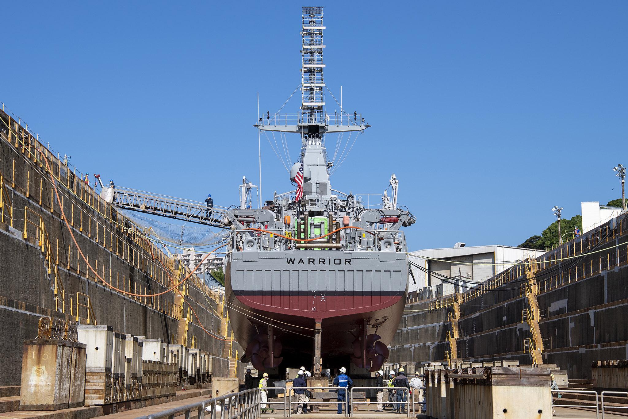 Ship repair facility personnel prepare to refloat the Avenger-class mine countermeasure ship USS Warrior (MCM 10) on June 10, 2020, in Sasebo, Japan. (David A. Berlin/Navy)