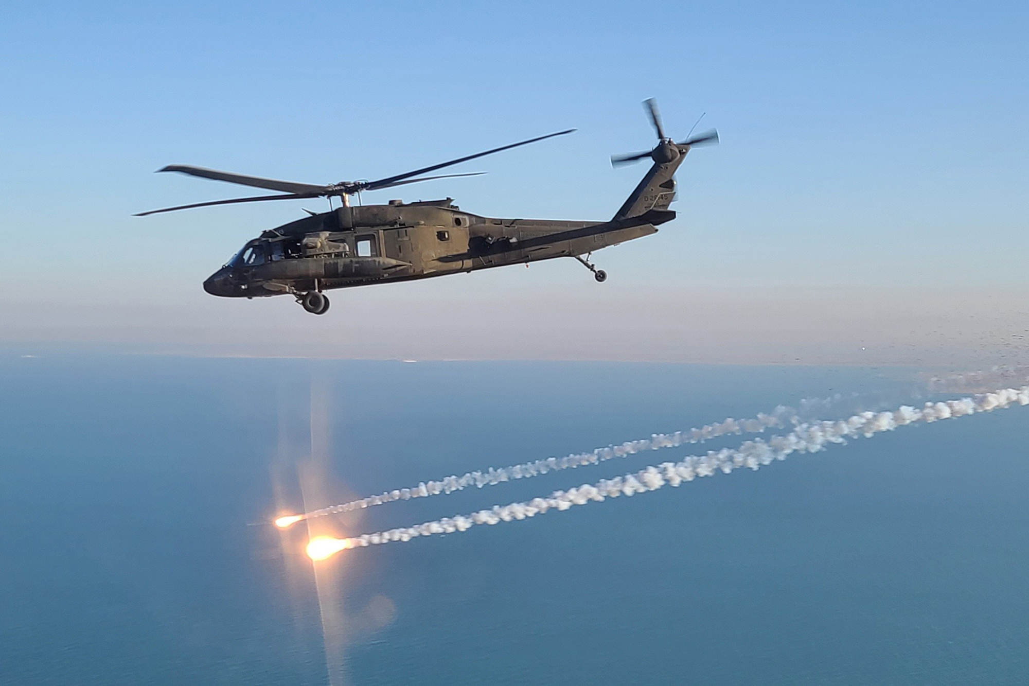 A UH-60 Black Hawk helicopter, operated by soldiers with Alpha Company, 2-104th General Support Aviation Battalion, 28th Expeditionary Combat Aviation Brigade, flies over the 28th ECAB's area of operations in the Middle East. (Sgt. Andrew Johnson/Army)