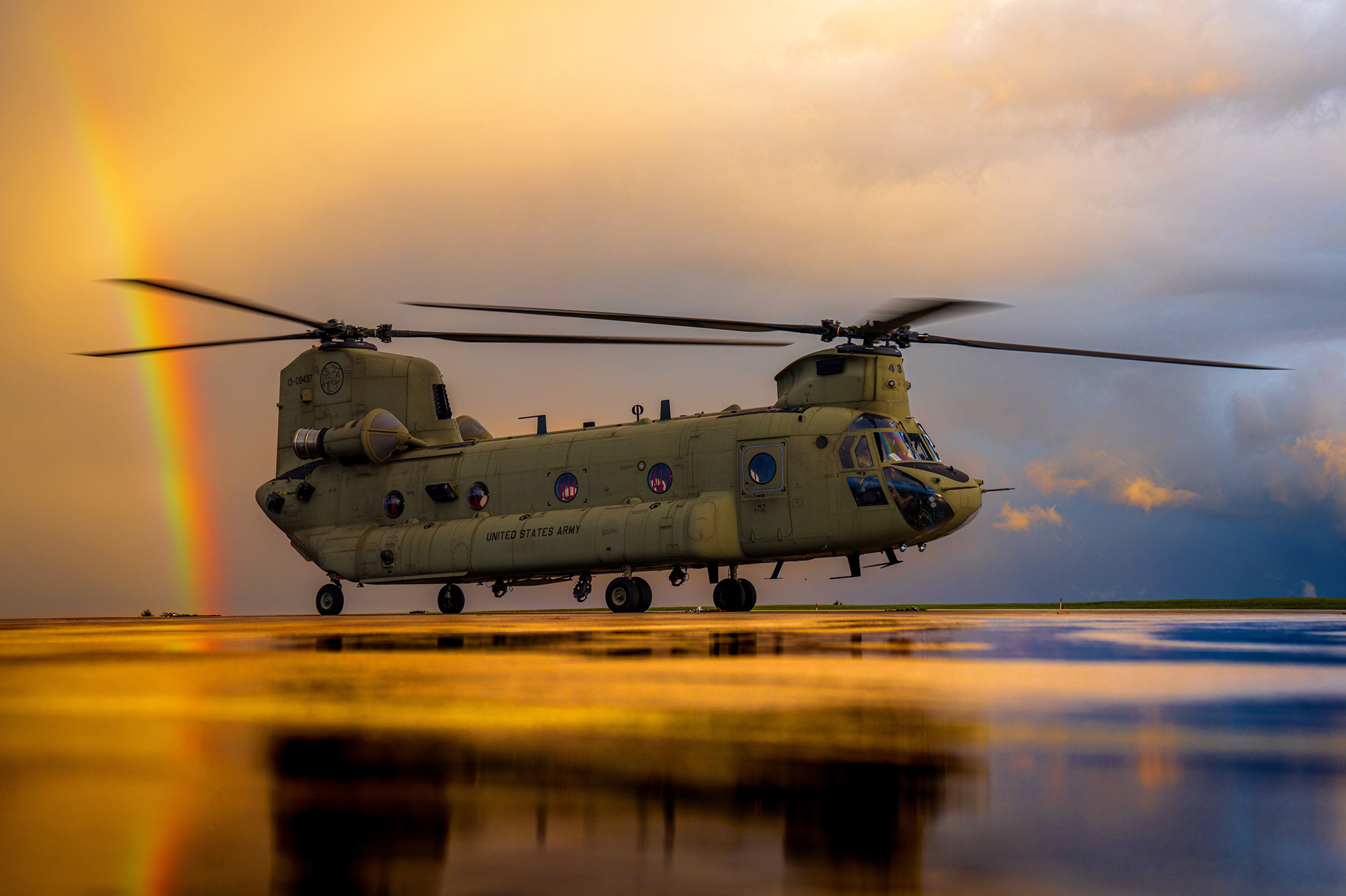 A CH-47 Chinook spins up for an evening training flight just after a storm clears on Oct. 6, 2020, at Katterbach Army Airfield in Germany. (Maj. Robert Fellingham/Army)
