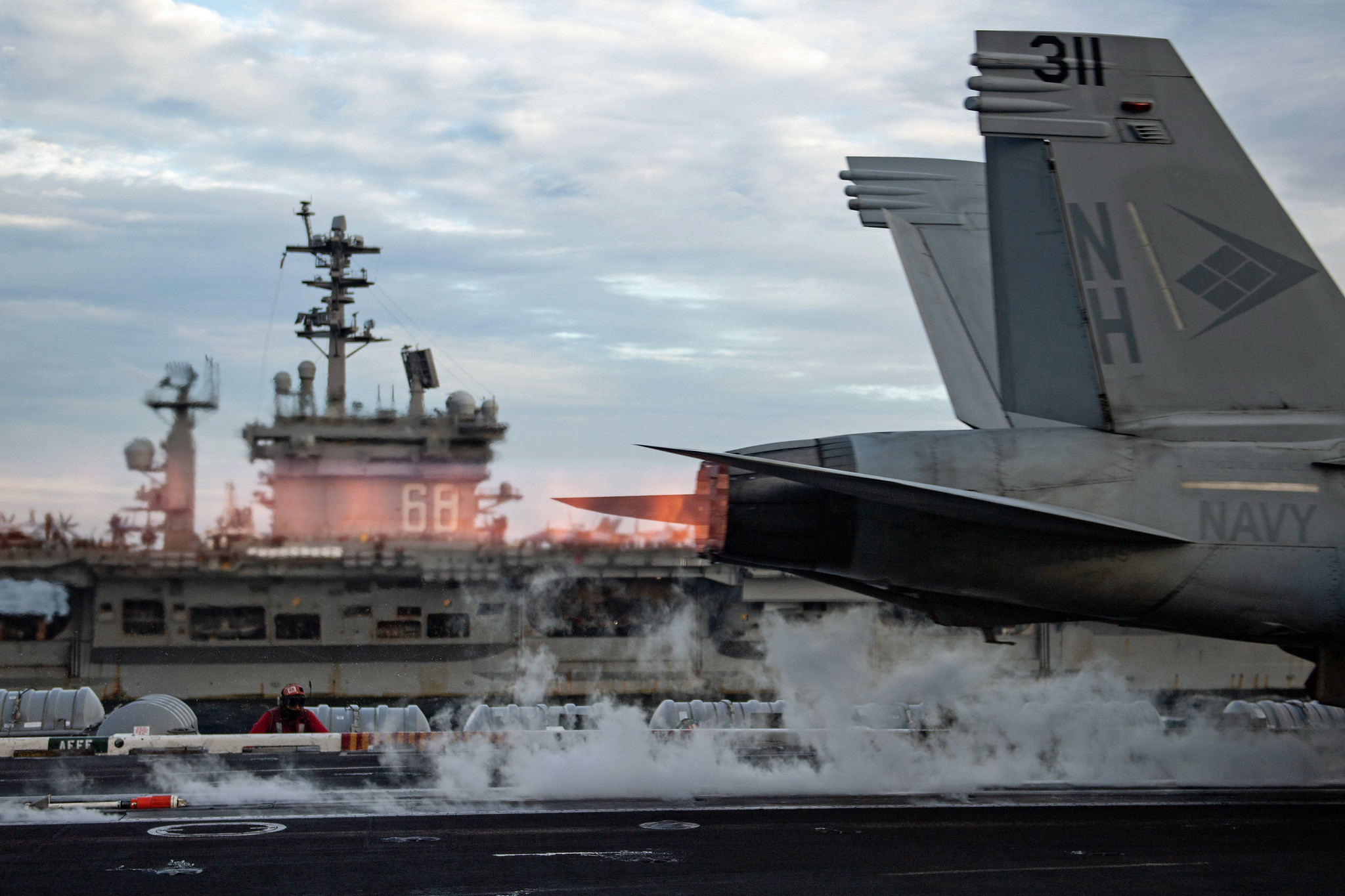 An F/A-18E Super Hornet launches from the flight deck of USS Theodore Roosevelt (CVN 71) while conducting dual-carrier operations with the Nimitz Carrier Strike Group in the South China Sea on Feb. 9, 2021. (MC2 Zachary Wheeler/Navy)