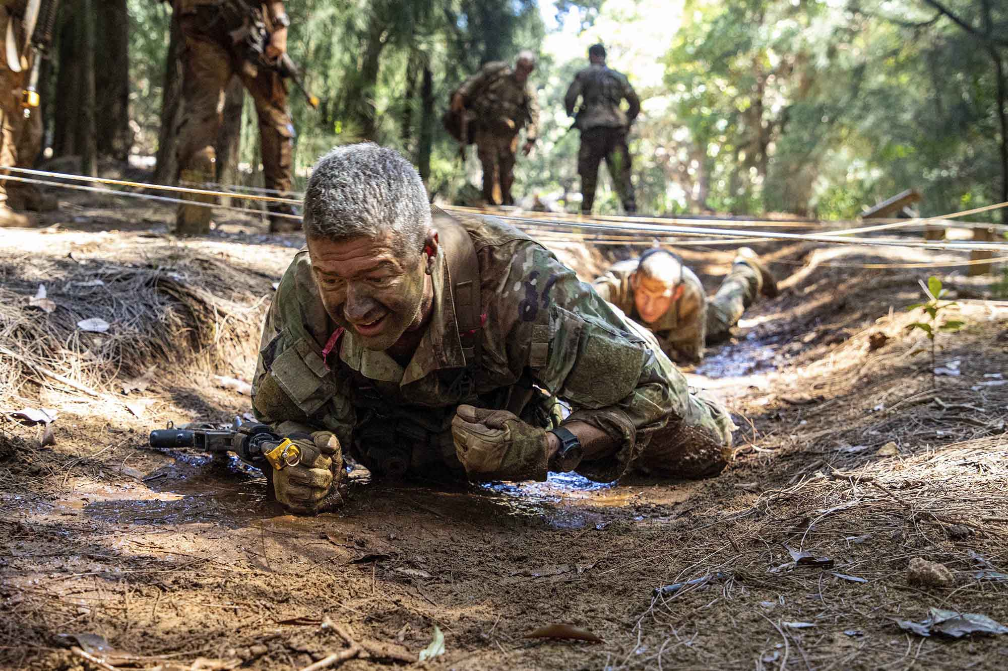 Soldiers assigned to 25th Infantry Division executed the Green Mile, a physical endurance course that concluded their training for the Jungle Operations Training Course, on April 1, 2021, at Lightning Academy near Schofield Barracks, Hawaii. (Sgt. Sarah D. Sangster/Army)