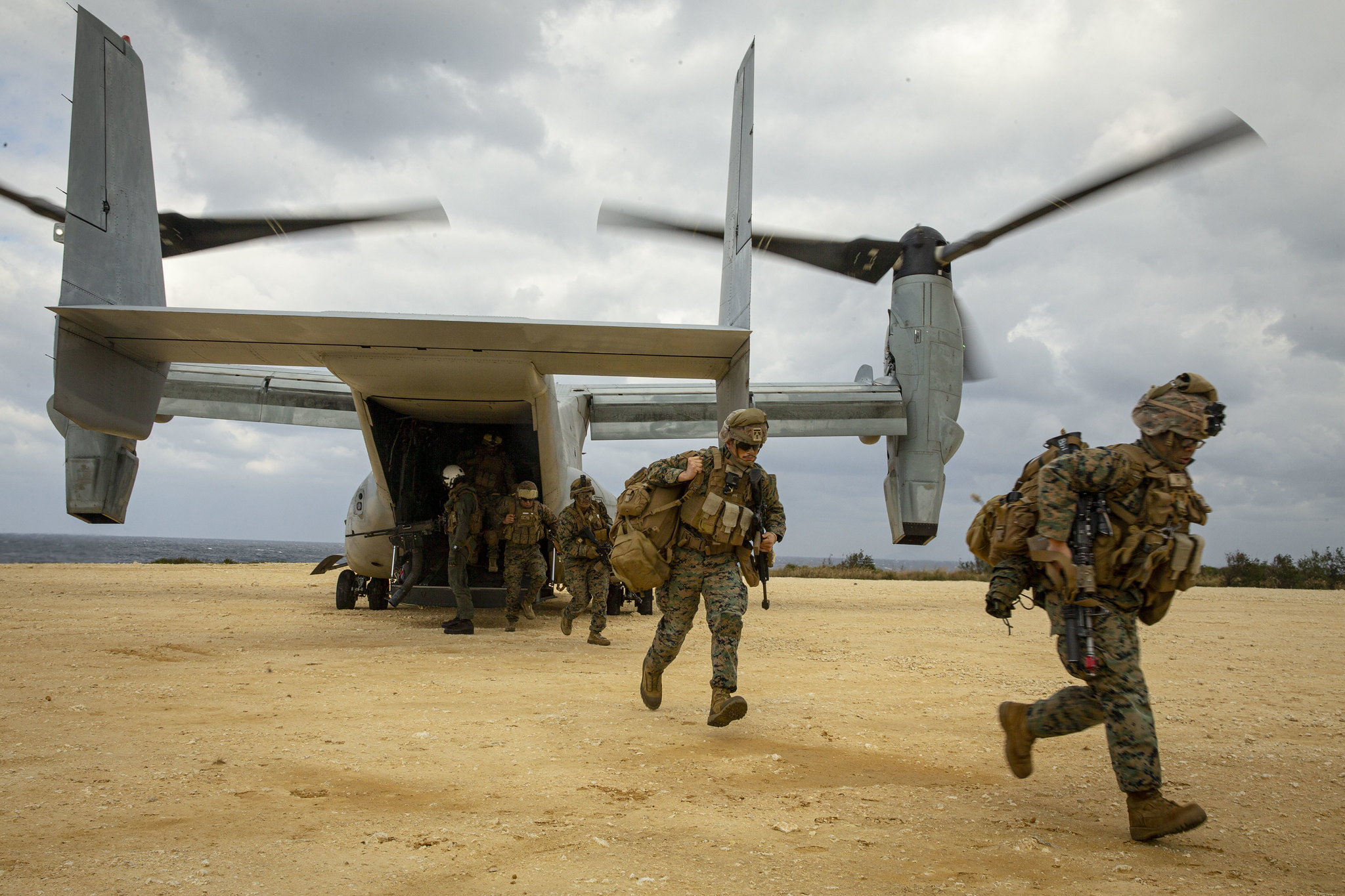 U.S. Marines run out of an MV-22B Osprey tiltrotor aircraft on Jan. 28, 2021, during an exercise on Ie Shima, Okinawa, Japan. (Cpl. Cody Rowe/Marine Corps)