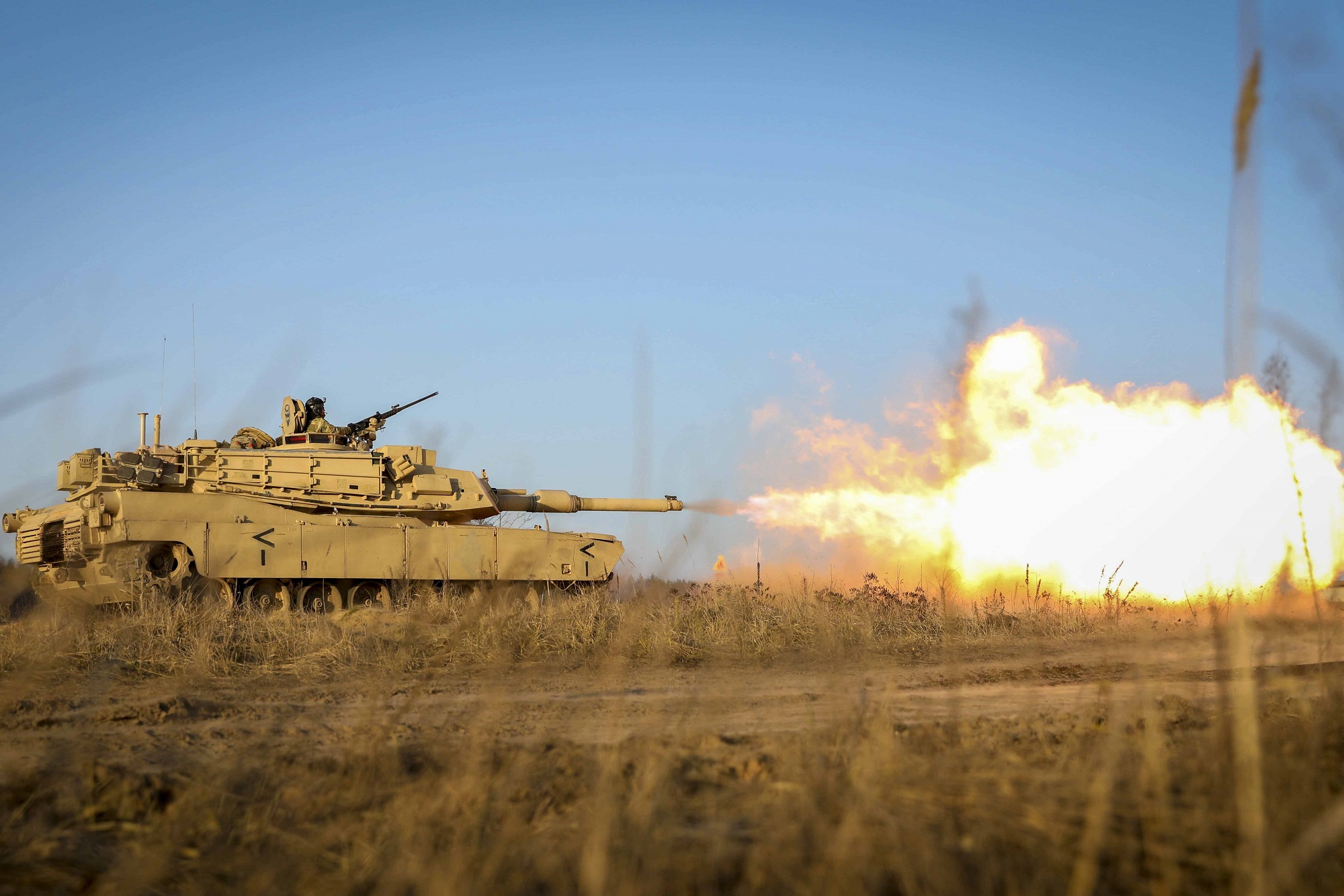 Gasses ignite as an M1 Abrams tank fires its main gun during a Dec. 10, 2020, live fire as part of the Ready to Fight operations after arriving to the Pabrade Training Area, Lithuania. (Sgt. Alexandra Shea/Army)