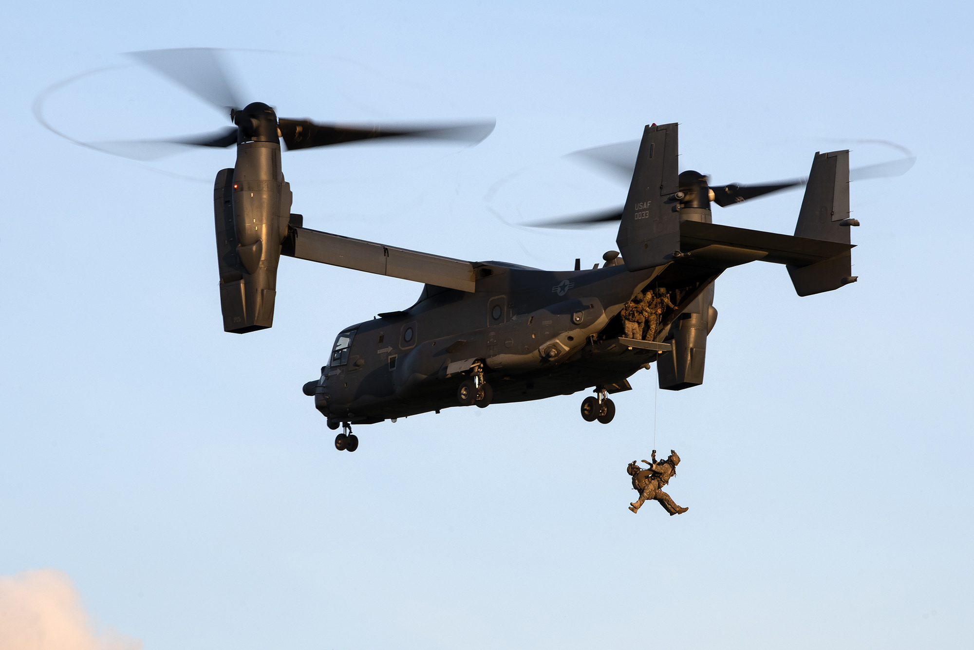 Special tactics operators assigned to the 321st Special Tactics Squadron tandem hoist into a CV-22B Osprey during a training exercise near RAF Mildenhall, United Kingdom, April 15, 2021. (Tech. Sgt. Westin Warburton/Air Force)