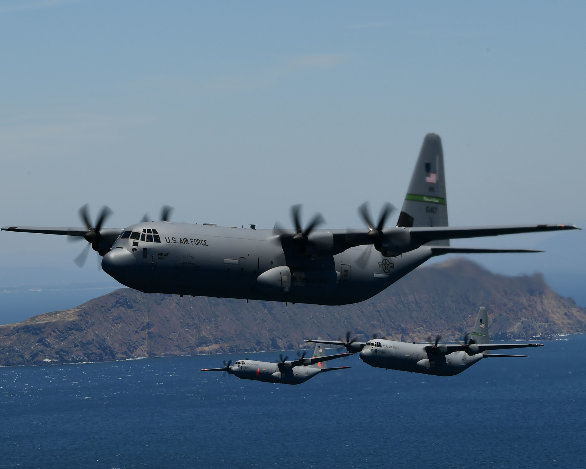 Four U.S. Air National Guard C-130J Super Hercules cargo aircraft from the California Air National Guard's 115th Airlift Squadron, 146th Airlift Wing, Port Hueneme, California, fly in formation during low-level tactical training near Anacapa Island, Calif., May 14, 2020. The tactical training was combined with a flyover a salute by the military to honor medical professionals and other essential workers serving on the front line of the COVID-19 pandemic. (Tech. Sgt. Nieko Carzis/Air National Guard)