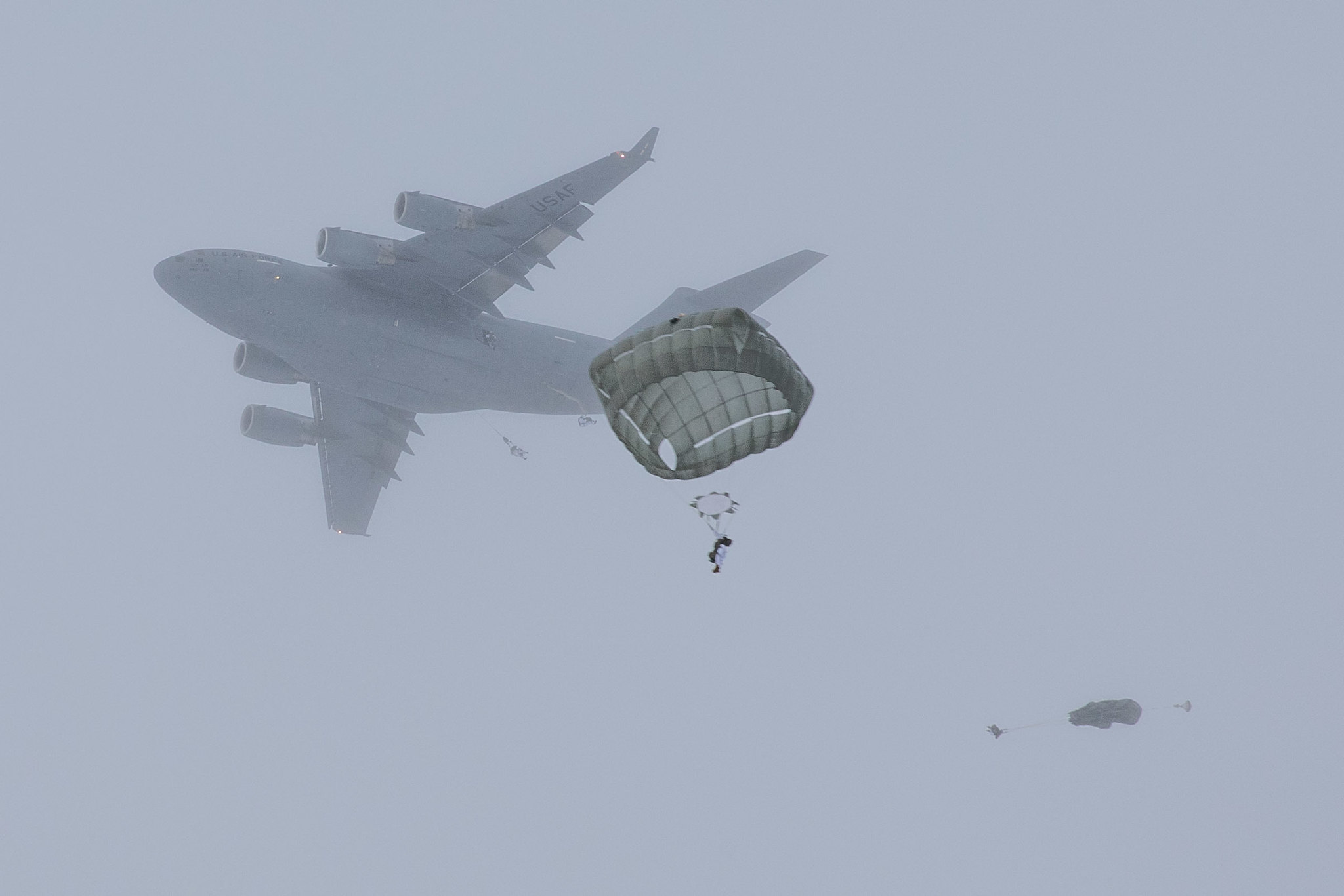 Paratroopers conduct an airborne operation at Malemute drop zone at Joint Base Elemendorf-Richardson, Alaska, Feb., 18, 2021. (Staff Sgt. Alex Skripnichuk/Army)