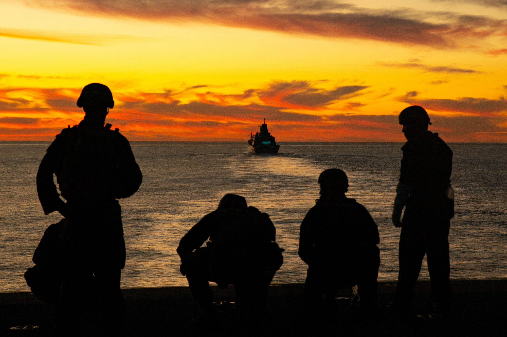Sailors and Marines aboard the Wasp-class amphibious assault ship USS Essex (LHD-2) post security from the flight deck during exercise Steel Knight/Dawn Blitz (SK/DB) 21 off the coast of Southern California, Dec. 4, 2020. (Lance Cpl. Cameron Rowe/Marine Corps)