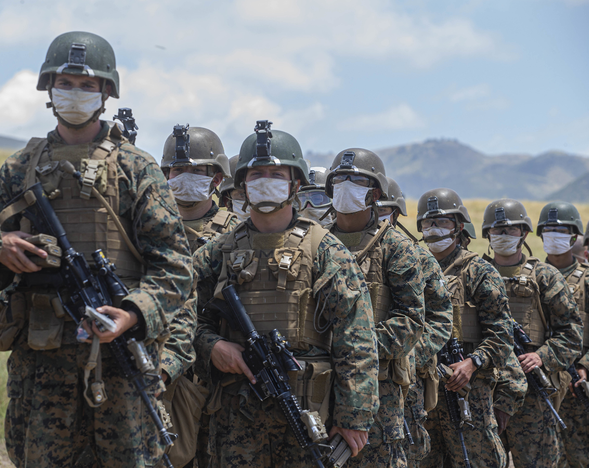 Marines with Alpha Company, Infantry Training Battalion, School of Infantry - West, wait to be lined out after live-fire training on Range 210F on Marine Corps Base Camp Pendleton, Calif., May 12, 2020. (Lance Cpl. Andrew Cortez/Marine Corps)