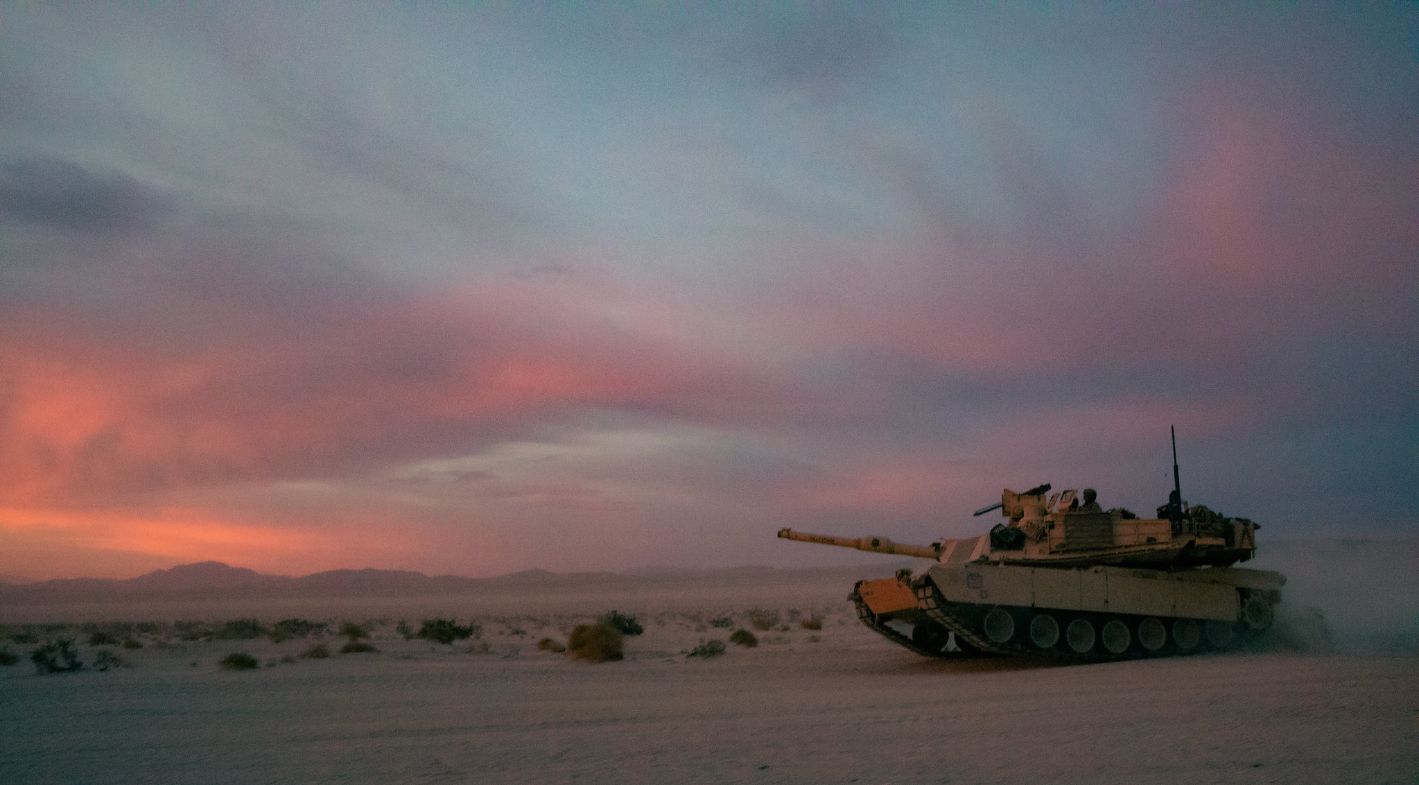An M1A2 Abrams tank assigned to the 155th Armored Brigade Combat Team, Mississippi Army National Guard, conducts maneuvers during training at the National Training Center, Fort Irwin, Calif., June 7, 2021. (Spc. Micah Longmire/Mississippi National Guard)