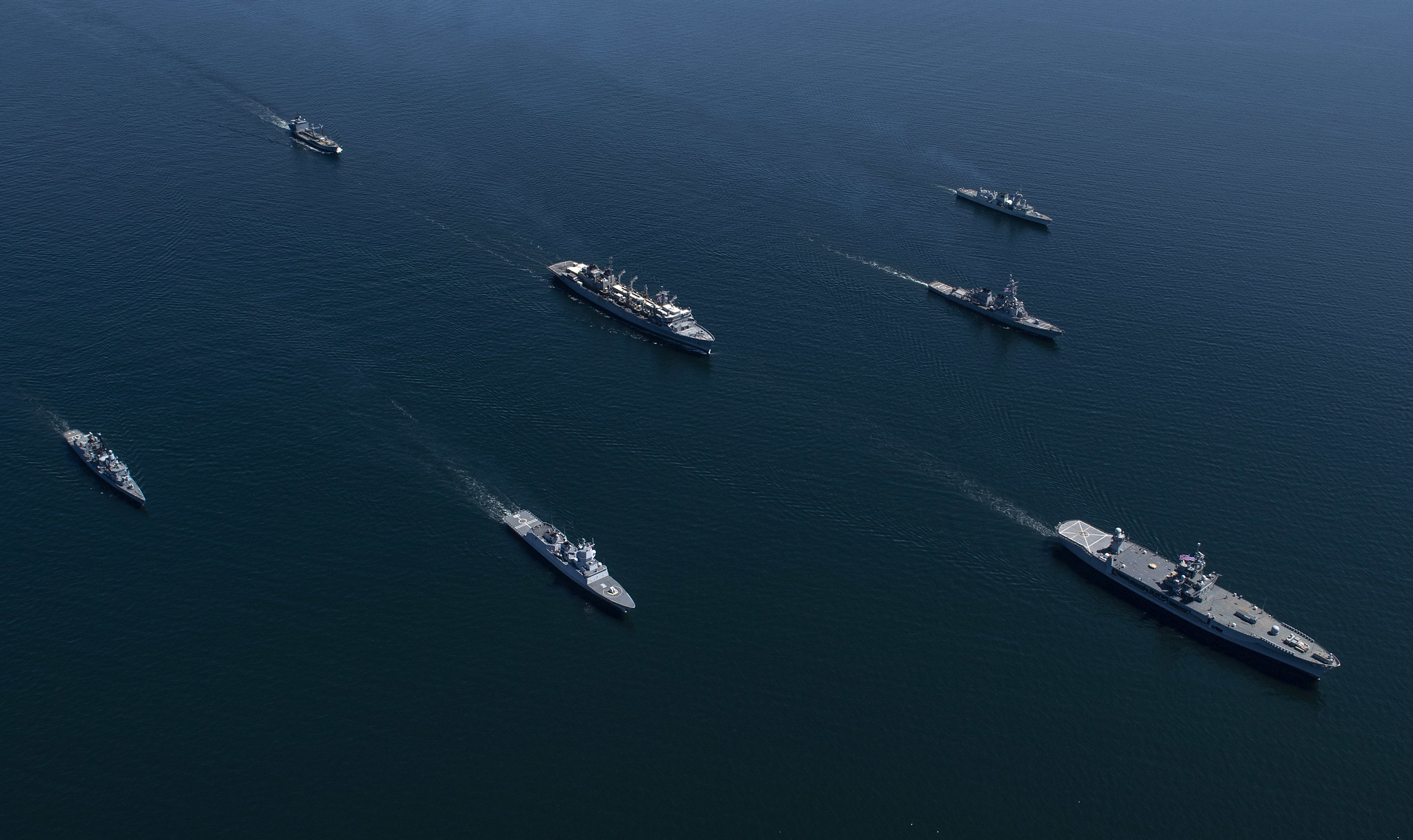 Ships from nations participating in exercise Baltic Operations (BALTOPS) 2020 sail in formation while in the Baltic Sea, June 8, 2020. The ships pictured in alphabetical order by home nation are the Royal Canadian Navy Halifax-class frigate HMCS Fredericton (FFH 337), the German navy Bremen-class frigate FGS Luebeck (F214) and the Rhone-Class replenishment oiler FGS Rhoen (A1443), the Royal Norwegian Navy Fridtjof Nansen-class frigate HNoMS Otto Suerdrup (F312), the U.S. Navy Blue Ridge-class command and control ship USS Mount Whitney (LCC 20), the Arleigh Burke-class guided-missile destroyer USS Donald Cook (DDG 75) and the Supply-class fast-combat support ship USNS Supply (T-AOE 6). (MC1 Kyle Steckler/Navy)
