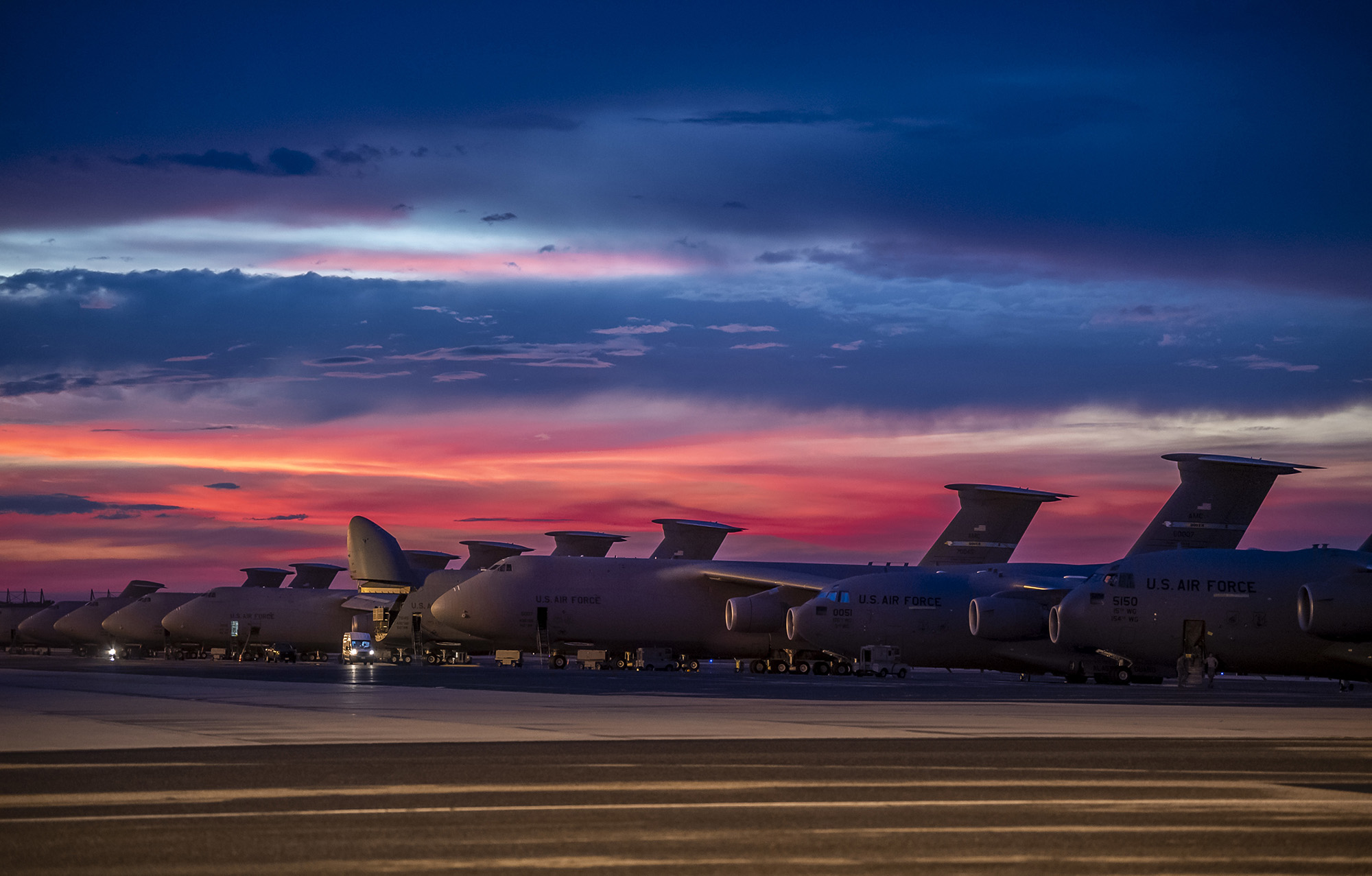 The sun sets over Dover Air Force Base, Del., as airmen work on the flightline Aug. 12, 2020. (Senior Airman Christopher Quail/Air Force)