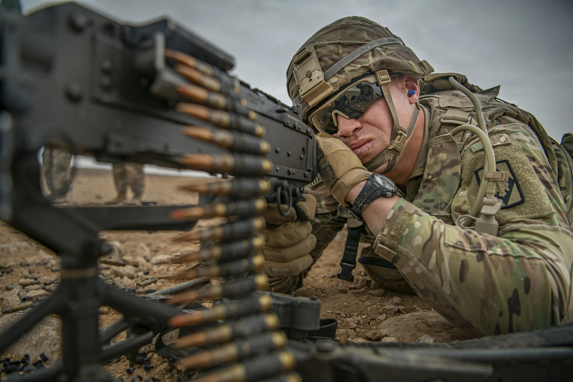 Staff Sgt. Dakota Montgomery fires an M240 machine gun during a weapon familiarization range on Nov. 28, 2020, while deployed to the Middle East in support of Operation Spartan Shield and Operation Inherent Resolve. (Sgt. Dustin D. Biven/Army)