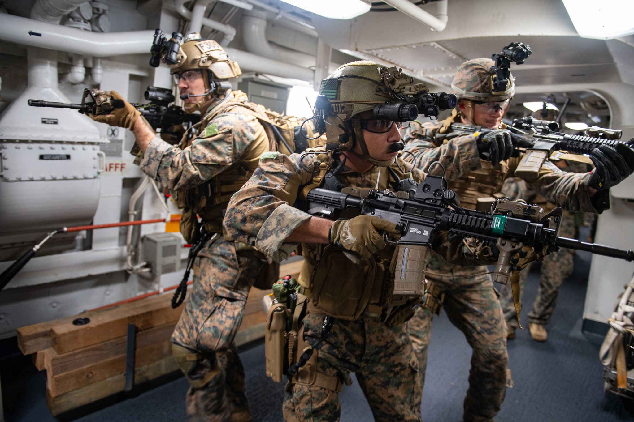 Marines attached to the 31st Marine Expeditionary Unit (MEU) search amphibious transport dock ship USS New Orleans (LPD 18) on June 14, 2021, during a maritime raid force training evolution with USS Germantown (LSD 42) in the East China Sea. (MC2 Desmond Parks/Navy)