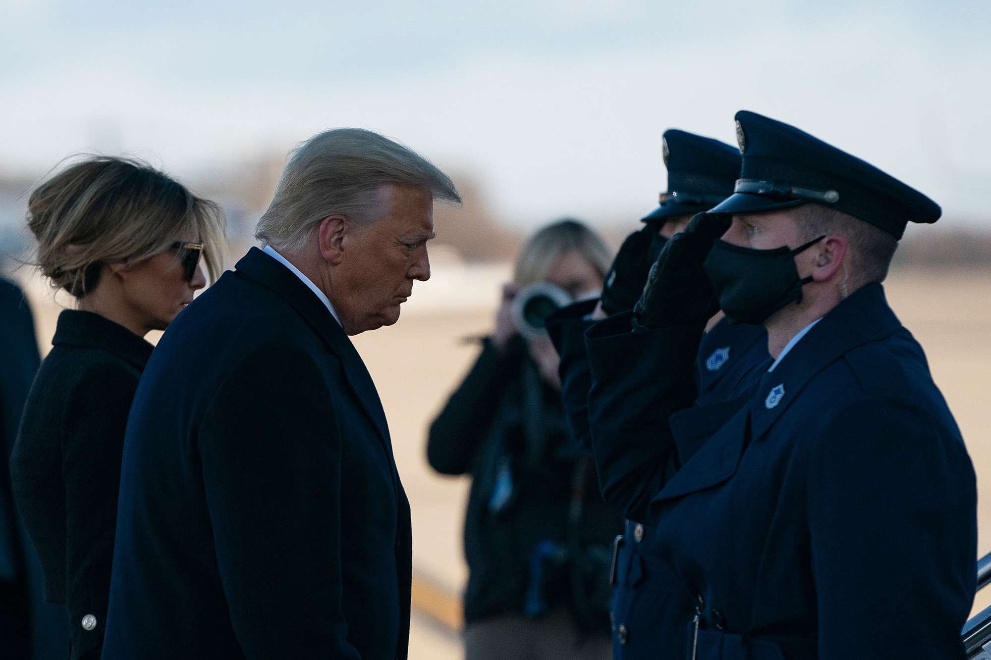 Outgoing President Donald Trump and first lady Melania Trump step out of Marine One at Joint Base Andrews in Maryland on Jan. 20, 2021. (Alex Edelman/AFP via Getty Images)