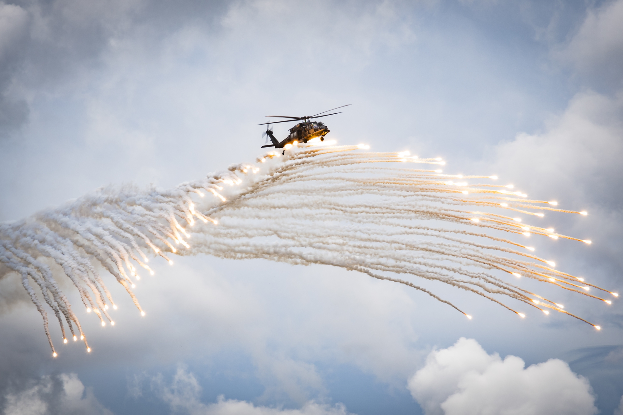 Airmen assigned to the 347th Rescue Group drop flares during a fini flight for Col. Bryan Creel, 347th RQG commander, June 5, 2020, at Moody Air Force Base, Ga. The fini flight is a long-standing Air Force tradition that occurs when a pilot departs from the base. Creel will move on to Incirlik Air Base, Turkey, where he will command the 39th Air Base Wing. (Senior Airman Hayden Legg/Air Force)