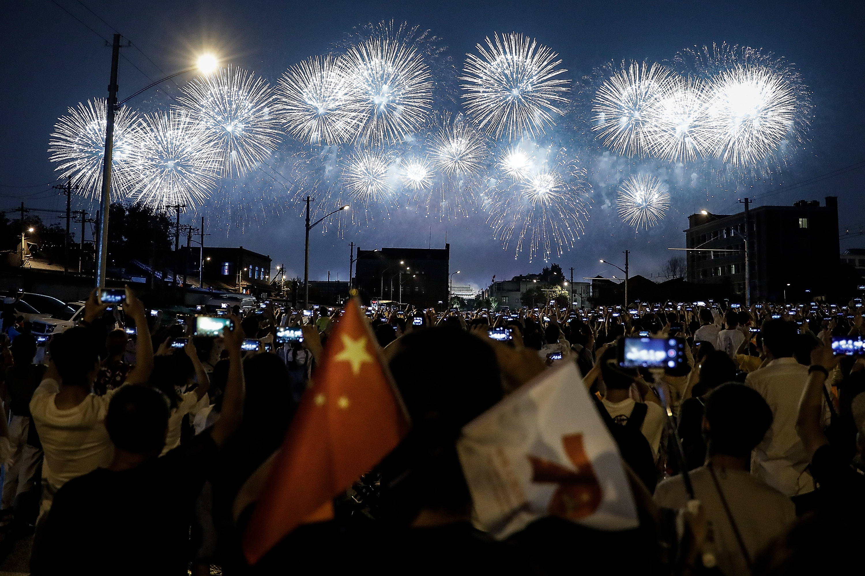 Fireworks explode during China's Oct. 1, 2019, parade in Beijing. (Wang He/Getty Images)