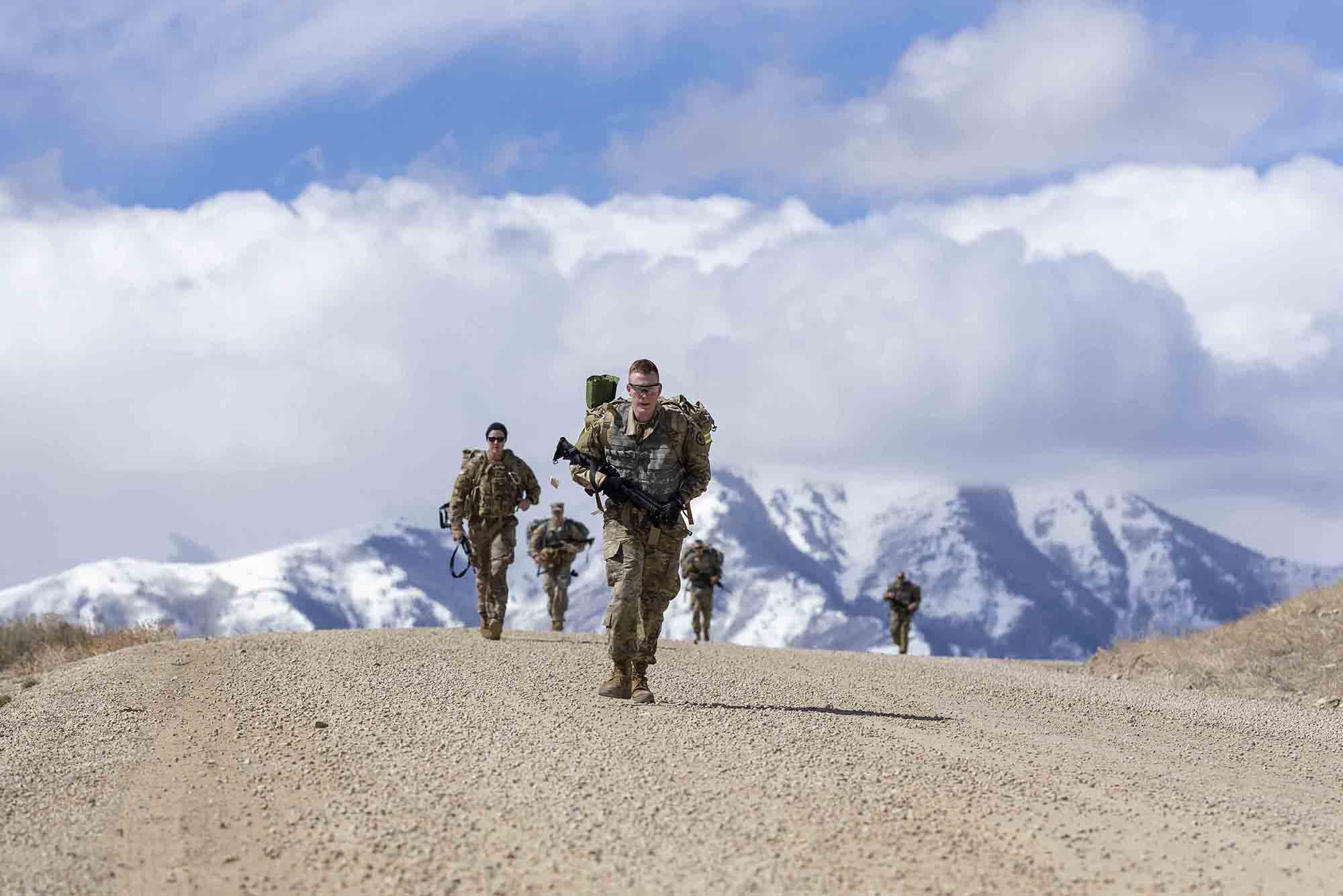 Soldiers endure a 6-mile ruck march back to garrison during the Utah National Guard Best Warrior Competition at Camp Williams, Utah, March 23, 2021. (Spc. Bryton Bluth/Army National Guard)