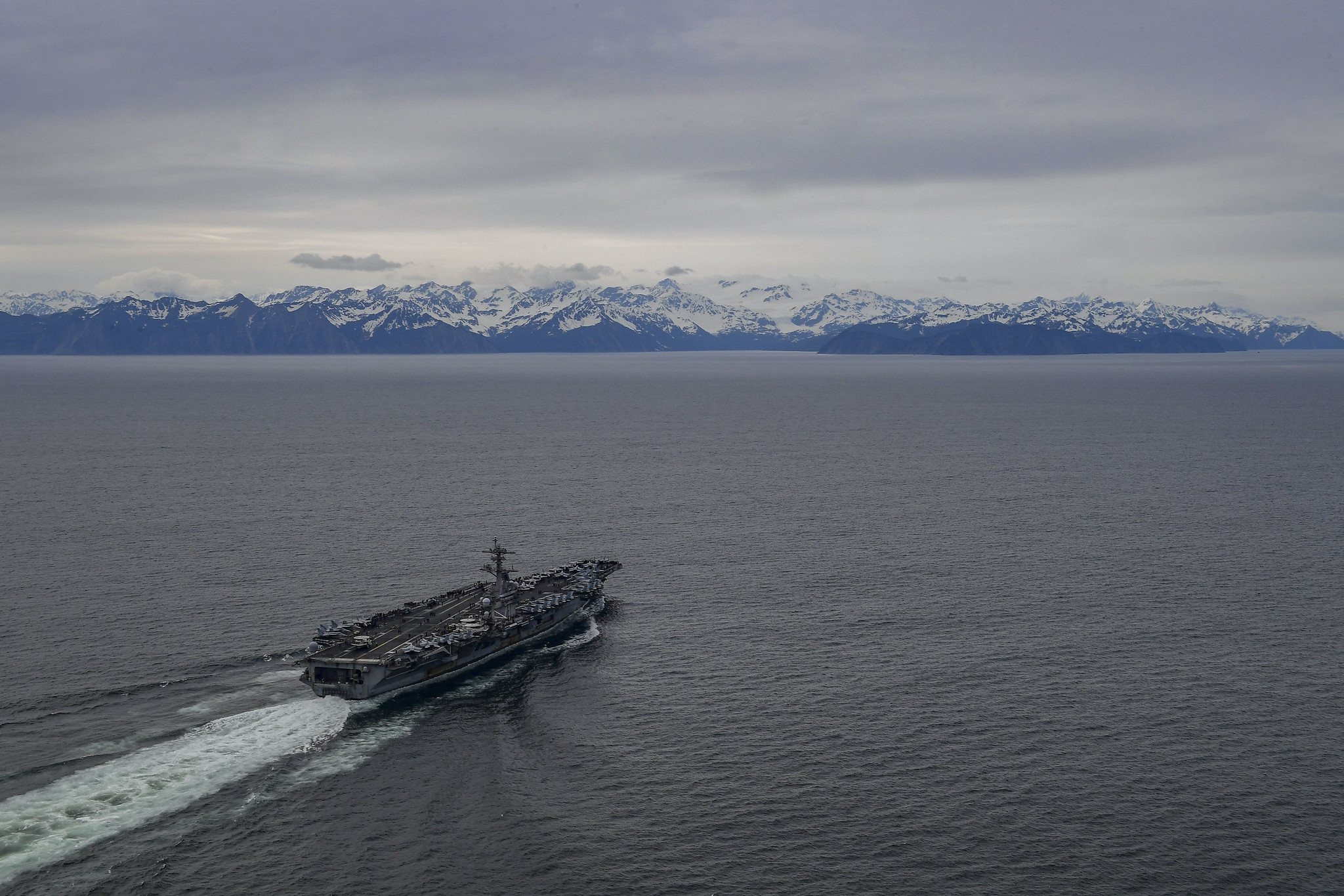 The aircraft carrier USS Theodore Roosevelt (CVN 71) transits the Gulf of Alaska, May 7, 2021, in support of flight operations above the Joint Pacific Alaska Range Complex and Gulf of Alaska during Exercise Northern Edge 2021 (NE21). (MC3 Brandon Richardson/Navy)