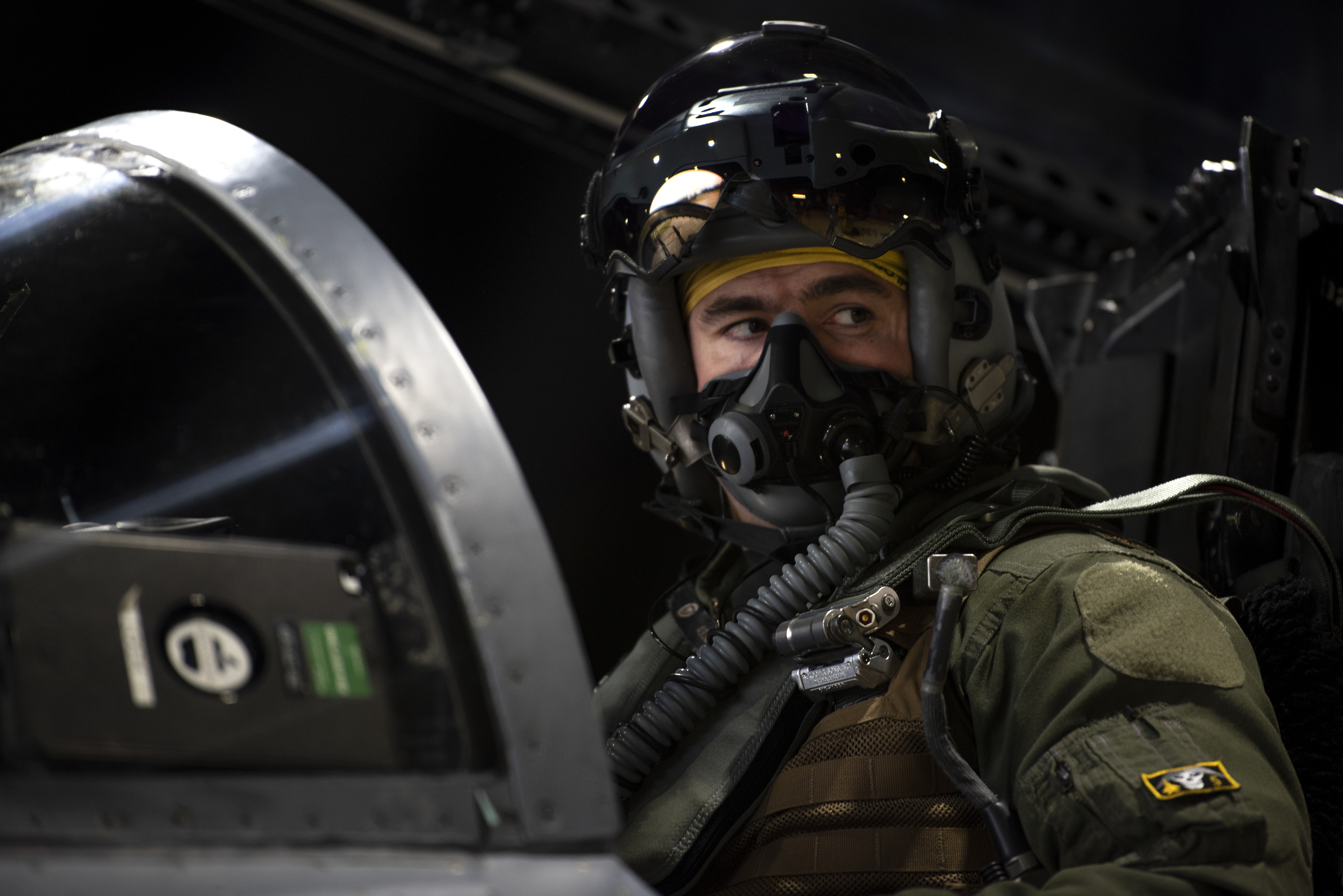 Maj. Andrew Smith, an F-15C Eagle pilot with the 48th Fighter Wing, conducts preflight checks in 2020 before taking off at Royal Air Force Lakenheath, England, during Exercise Point Blank 20-3. (Airman 1st Class Jessi Monte/U.S. Air Force)