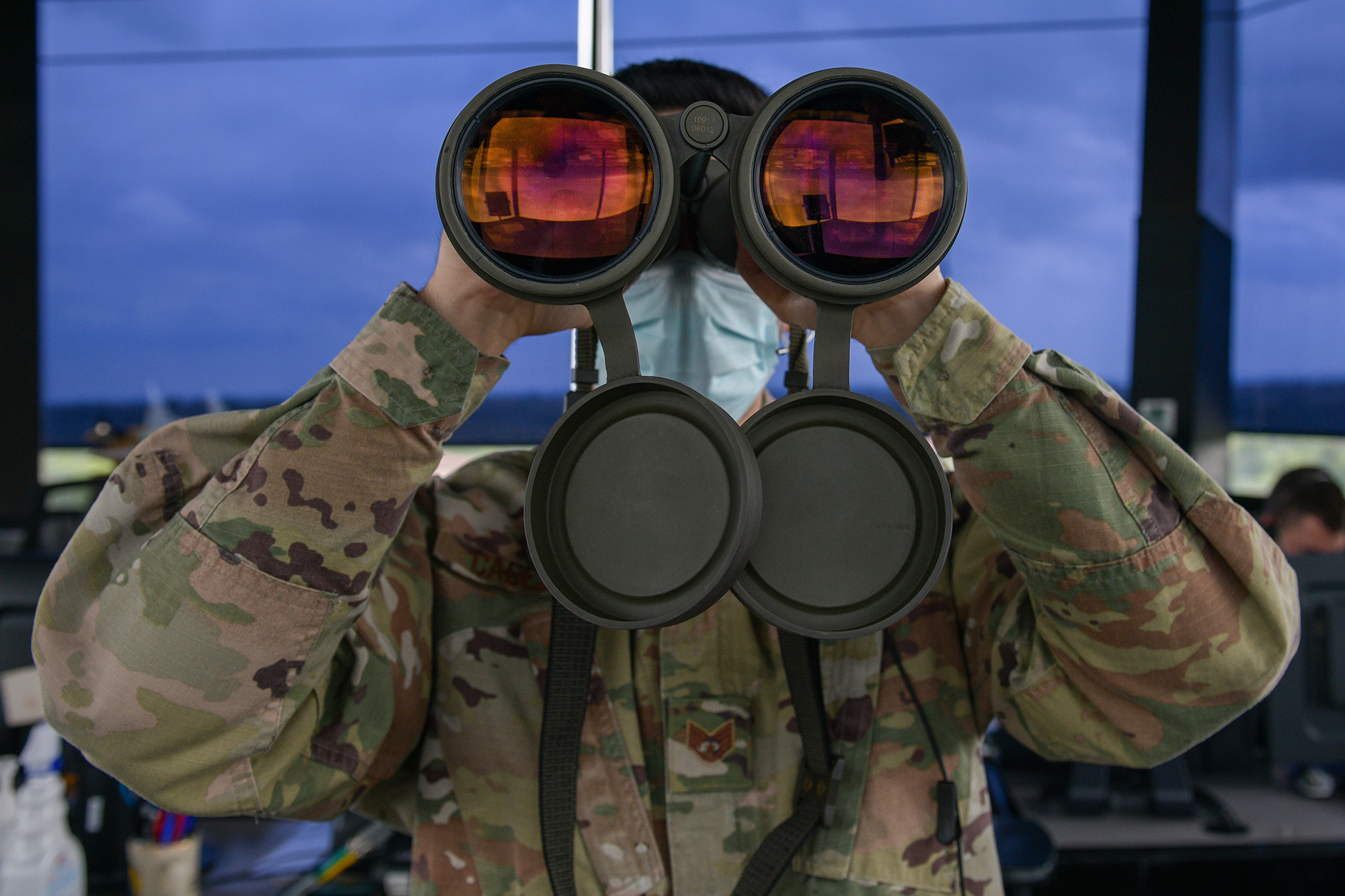 Air Force Staff Sgt. Daniel Cabezas scans the horizon for landing lights and obstructions on the flightline at Aviano Air Base, Italy, May 7, 2021. (Airman 1st Class Brooke Moeder/Air Force)