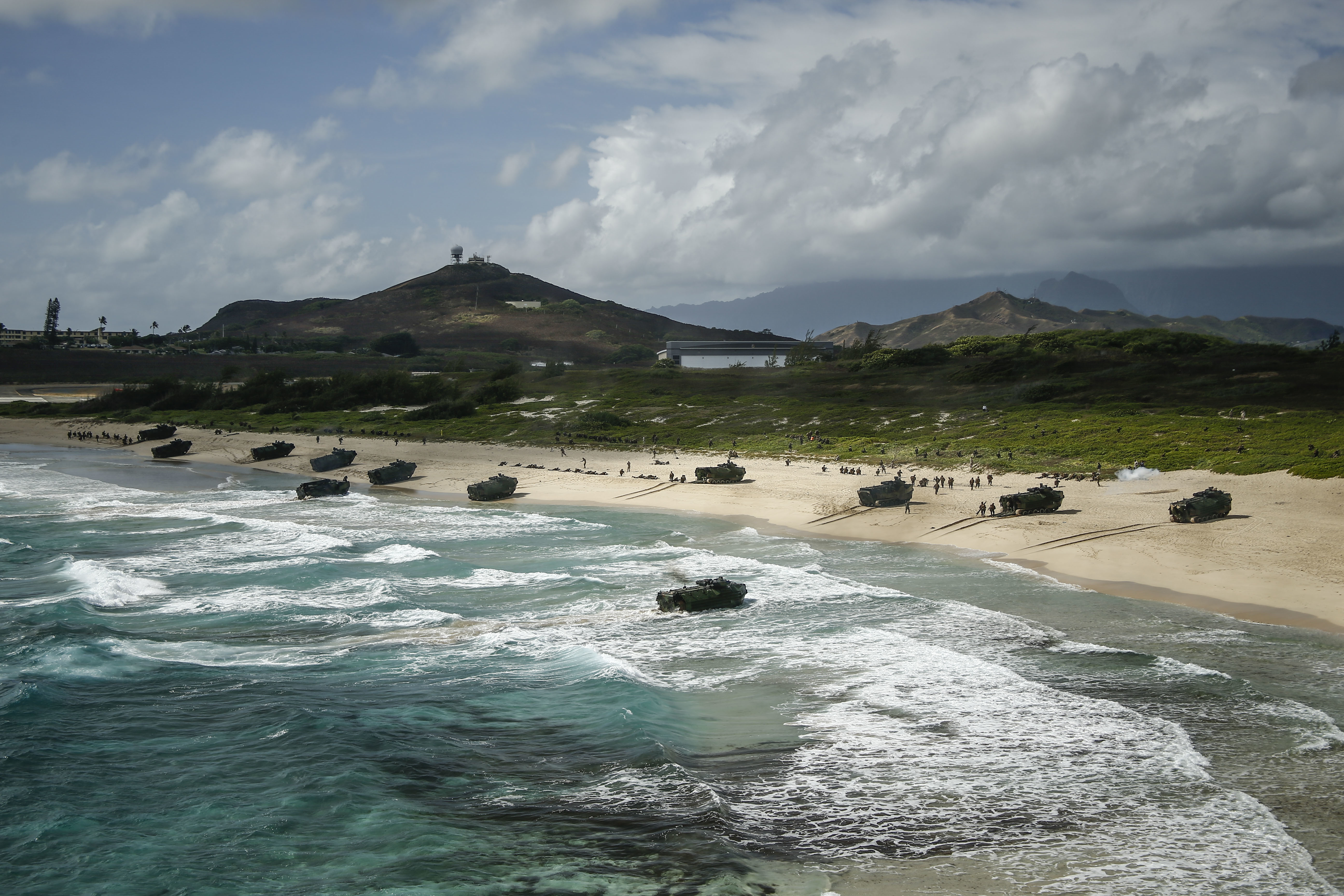 U.S. Marine Corps AAV-P7/A1 assault amphibious vehicles assigned to Combat Assault Company, 3rd Marine Regiment, unload service members during an amphibious landing demonstration as part of Rim of the Pacific (RIMPAC) exercise at Pyramid Rock Beach on Marine Corps Base Hawaii July 29, 2018. Sgt. Aaron S. Patterson/US Marine Corps.