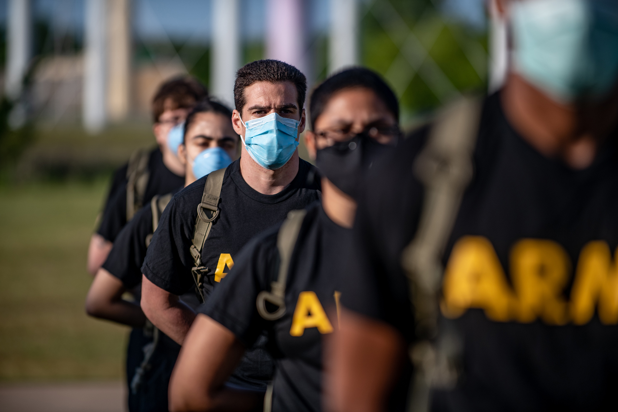 Soldiers from 95th Adjutant General Battalion, 434th Field Artillery Brigade, Fort Sill, Okla., stand in formation while wearing masks and maintaining physical distancing during reception before entering basic combat training May 14, 2020, on Fort Sill. (Sgt. Dustin D. Biven/Army)