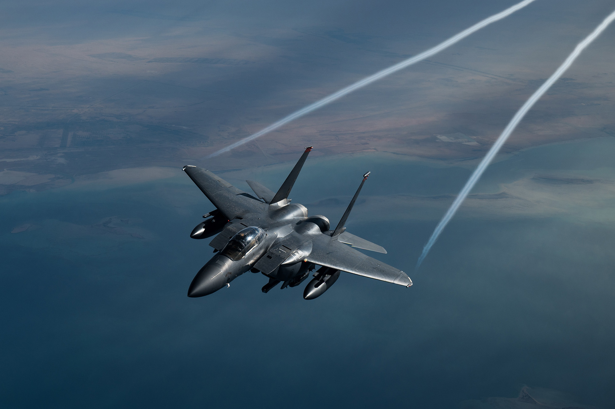 A U.S. Air Force F-15 Strike Eagle flies over the U.S. Central Command area of responsibility, Feb. 10, 2021.(Staff Sgt. Sean Carnes/Air Force)