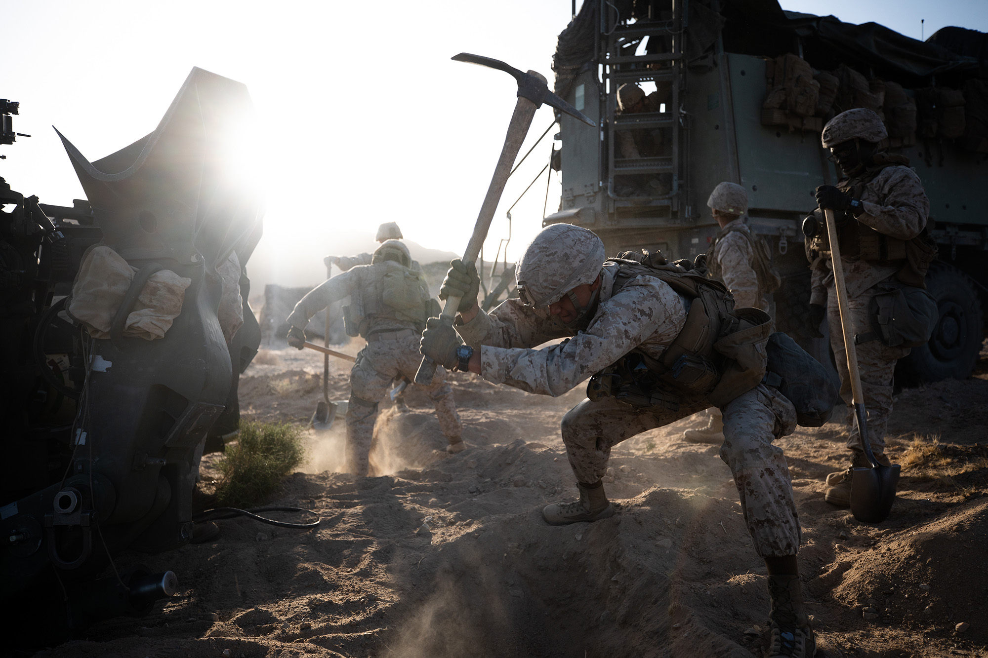 Marine Corps Pfc. Aristeo Morales digs an entrenchment for an M777 towed 155 mm howitzer during a live-fire defense simulation at the Marine Corps Air Ground Combat Center in Twentynine Palms, Calif., March 30, 2021. (Cpl. Jamin M. Powell/Marine Corps)