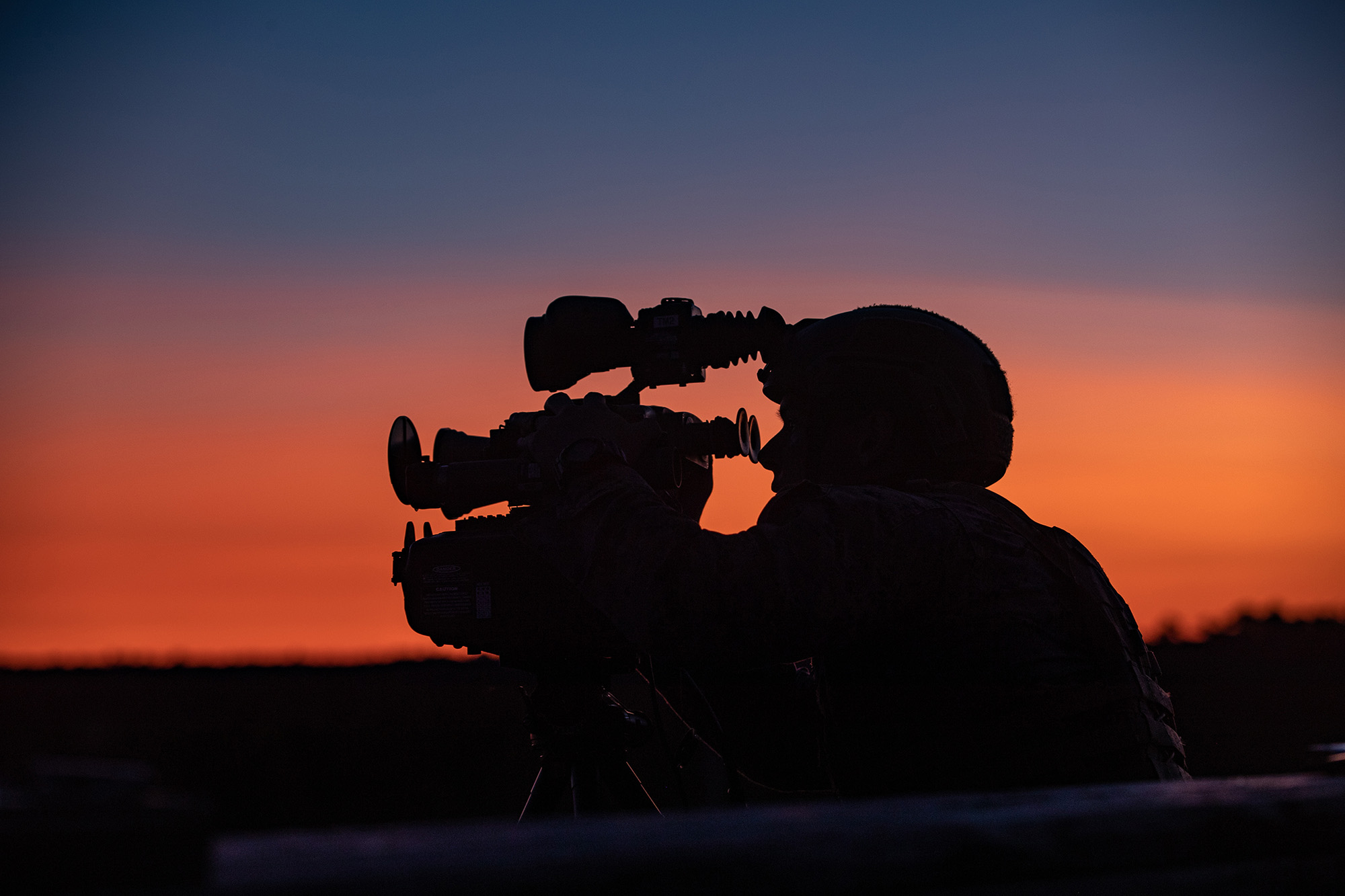 Marine Corps Staff Sgt. Brock Legant, an instructor at Scout Sniper Instructor School, rehearses his skills on night observation equipment during Tactical Air Control Party 1-21 on Camp Lejeune, N.C., Nov. 3, 2020. (Lance Cpl. Jacqueline Parsons/Marine Corps)