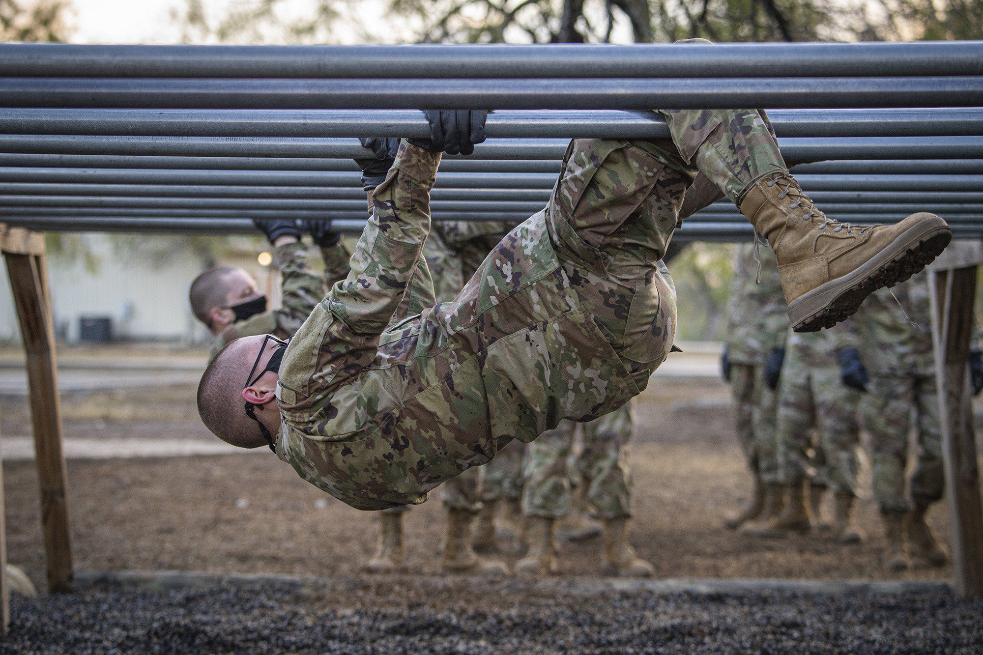 A U.S. Space Force trainee participates on the over-and-under bars obstacle during Basic Expeditionary Airman Skills Training at Joint Base San Antonio-Chapman Annex, Texas, Dec. 2, 2020. This trainee was among the first to attend basic military training before entering the operational Space Force, which was established as the sixth military branch, Dec. 20, 2019. (Staff Sgt. James R. Crow/Air Force)