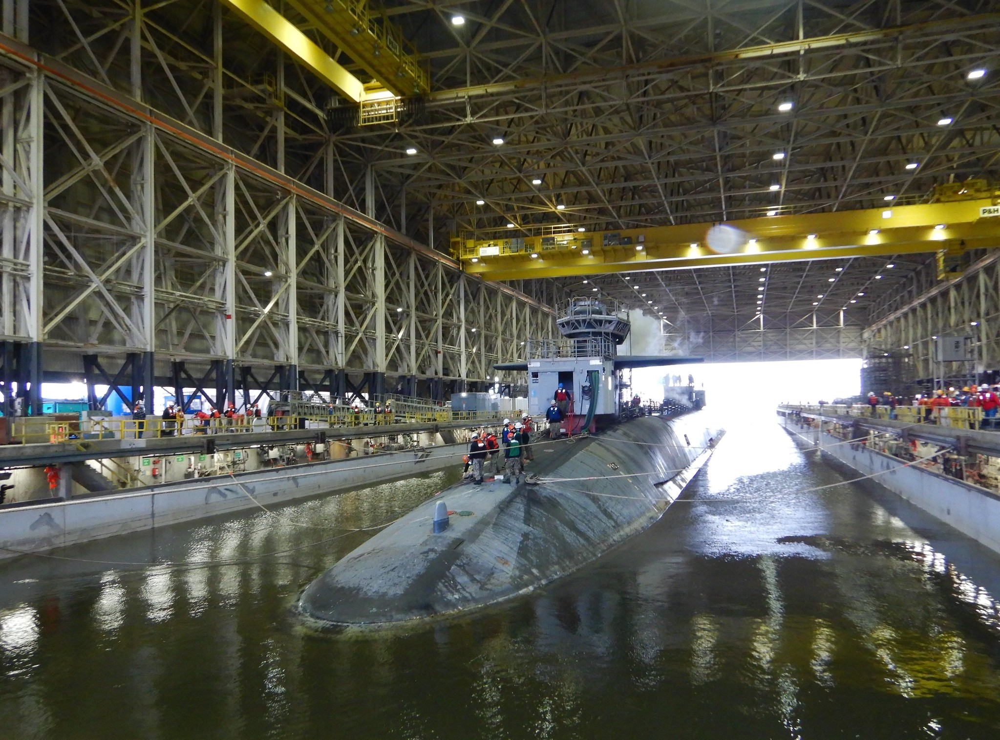 The Ohio-class ballistic-missile submarine USS Tennessee (SSBN 734) enters the Trident Refit Facility, Kings Bay, Ga., dry dock Feb. 1, 2021, for an extended refit period. Tennessee will be the last submarine in the dry dock before a $554 million dry dock refurbishment project begins later this summer. (Elaine Rilatt/Navy)