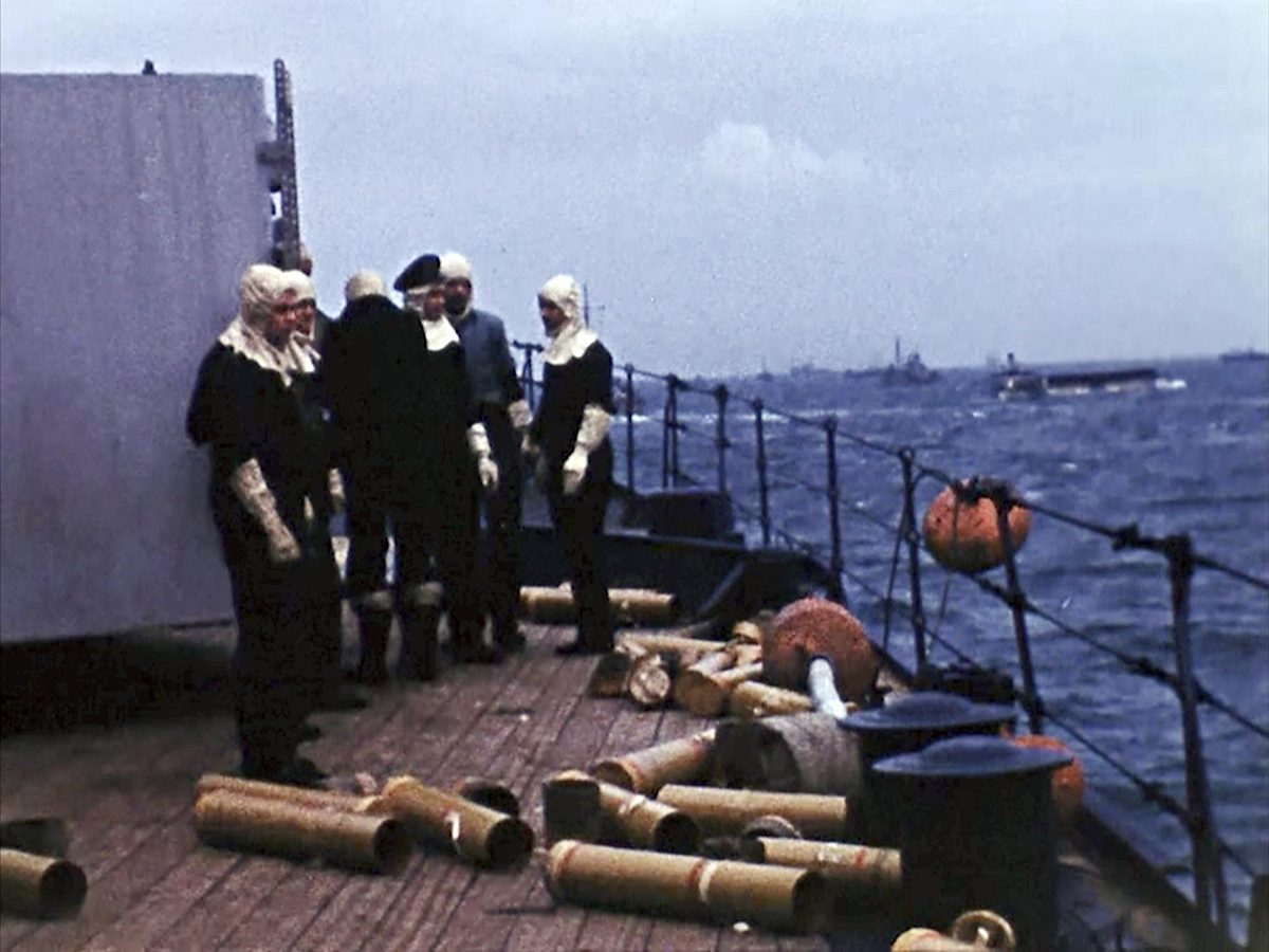 Empty shells on the deck of a ship off the coast of France on D-Day, June 6, 1944. Seventy-five years later, surprising color images of the D-Day invasion and aftermath bring an immediacy to wartime memories. They were filmed by Hollywood director George Stevens and rediscovered years after his death. (War Footage From the George Stevens Collection at the Library of Congress via AP)