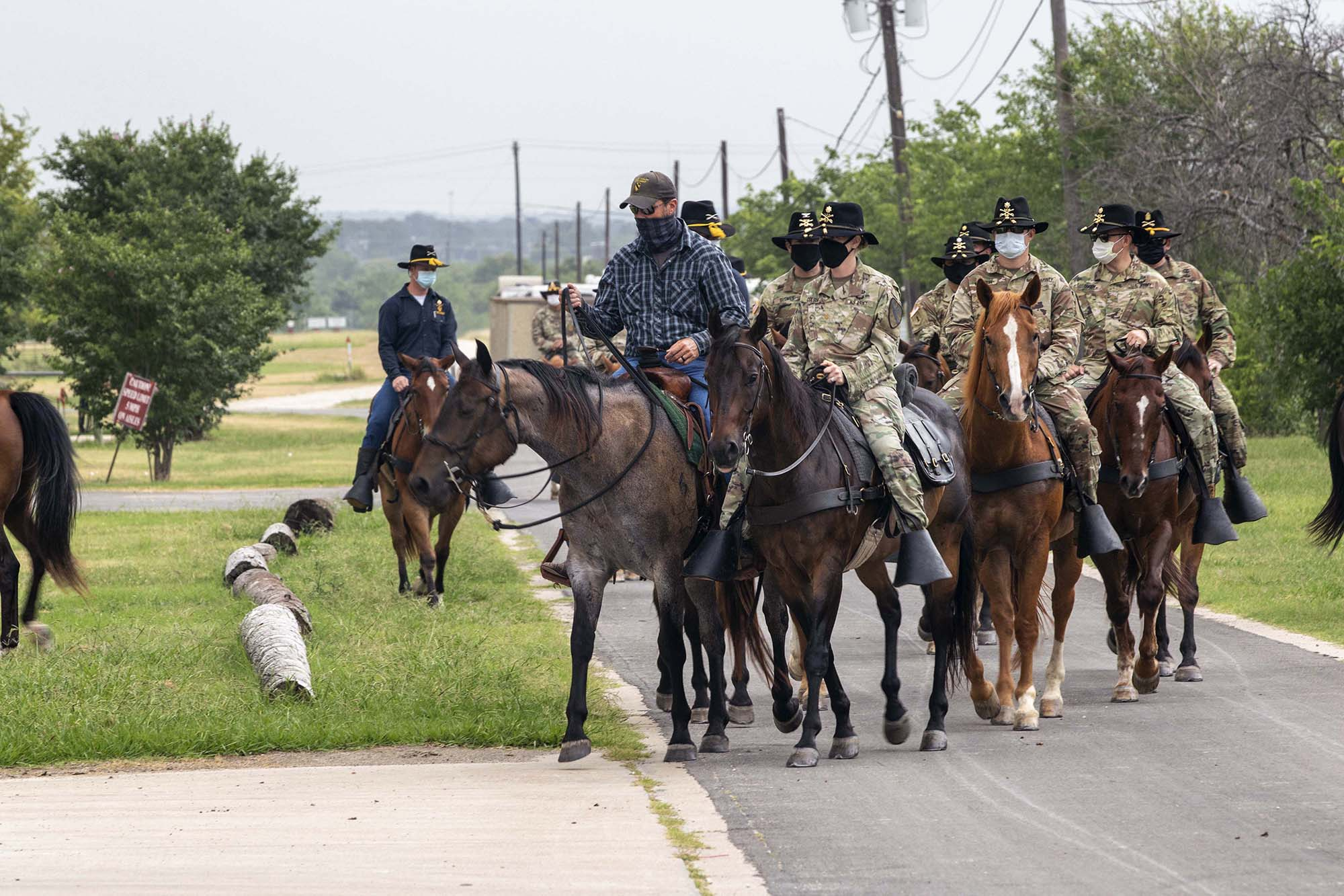 Senior leaders and command teams from 1st Cavalry Division Sustainment Brigade come together in First Team tradition for a trail ride led by the 1st Cavalry Division Horse Detachment, Fort Hood, Texas, July 1, 2020. (Sgt. Calab Franklin/Army)