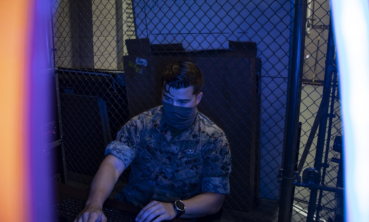 The DoD faces a challenge with managing cyberspace and the information warfare sphere. Pictured here, a Marine cyberspace intelligence analyst interprets network data. (Cpl. Seth Rosenberg/Marine Corps)