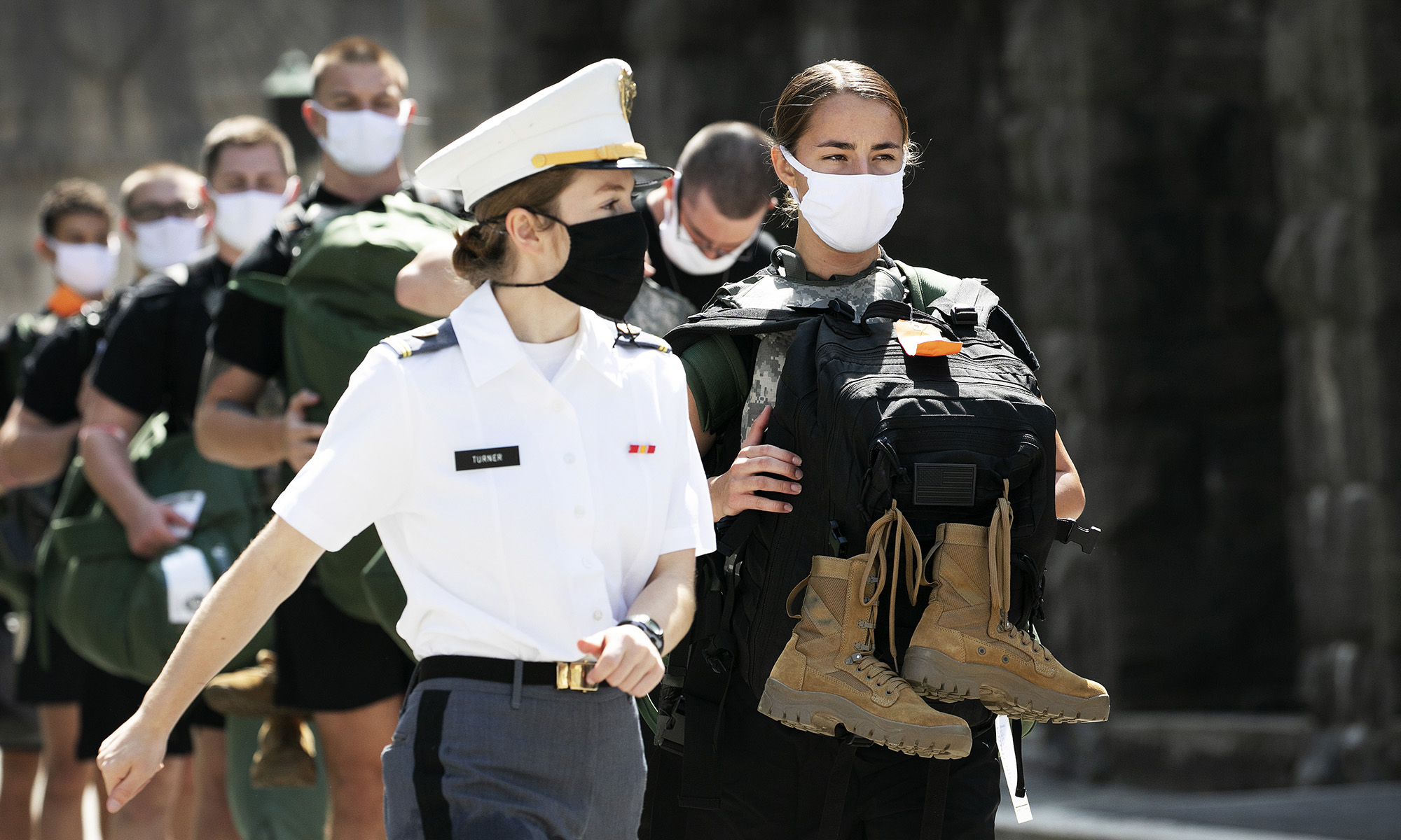 A West Point cadet leads a formation of new cadets on July 13, 2020, at the U.S. Military Academy in West Point, N.Y. The Army is welcoming more than 1,200 candidates from every state. Candidates will be COVID-19 tested immediately upon arrival, wear masks, and practice social distancing. (Mark Lennihan/AP)