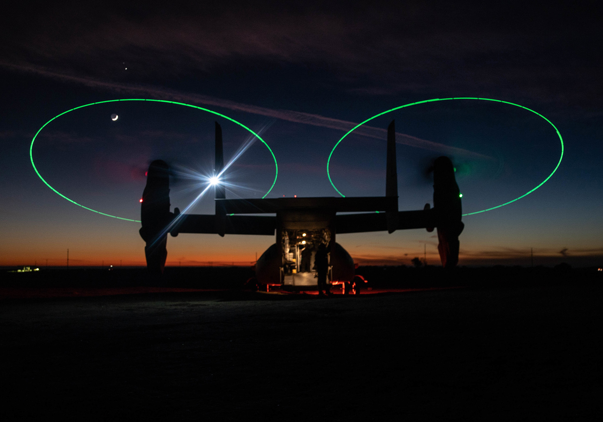 An MV-22 Osprey stages during a night during a Tactical Recovery of Aircraft and Personnel (TRAP) exercise at Marine Corps Base Camp Pendleton, Calif., Dec. 16, 2020. (Sgt. Jennessa Davey/Marine Corps)