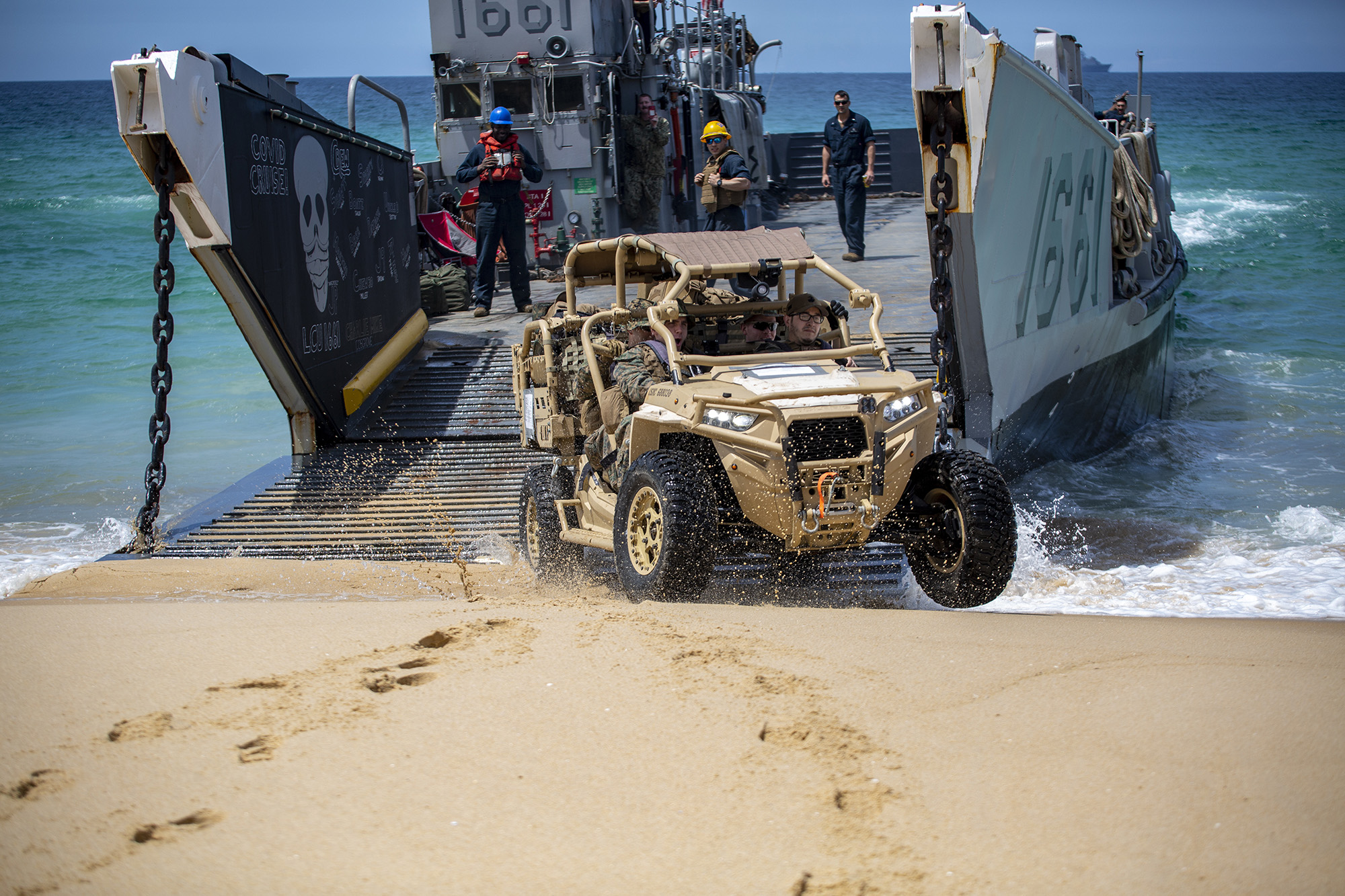 Landing Craft Utility (LCU) 1661 deploys a Utility Tactical Vehicle during CONTEX-PHIBEX, a bilateral amphibious exercise between the U.S. and Portuguese naval services, May 9, 2021, in Pinhiero Da Cruz, Portugal. (1st Lt. Mark Andries/Marine Corps)