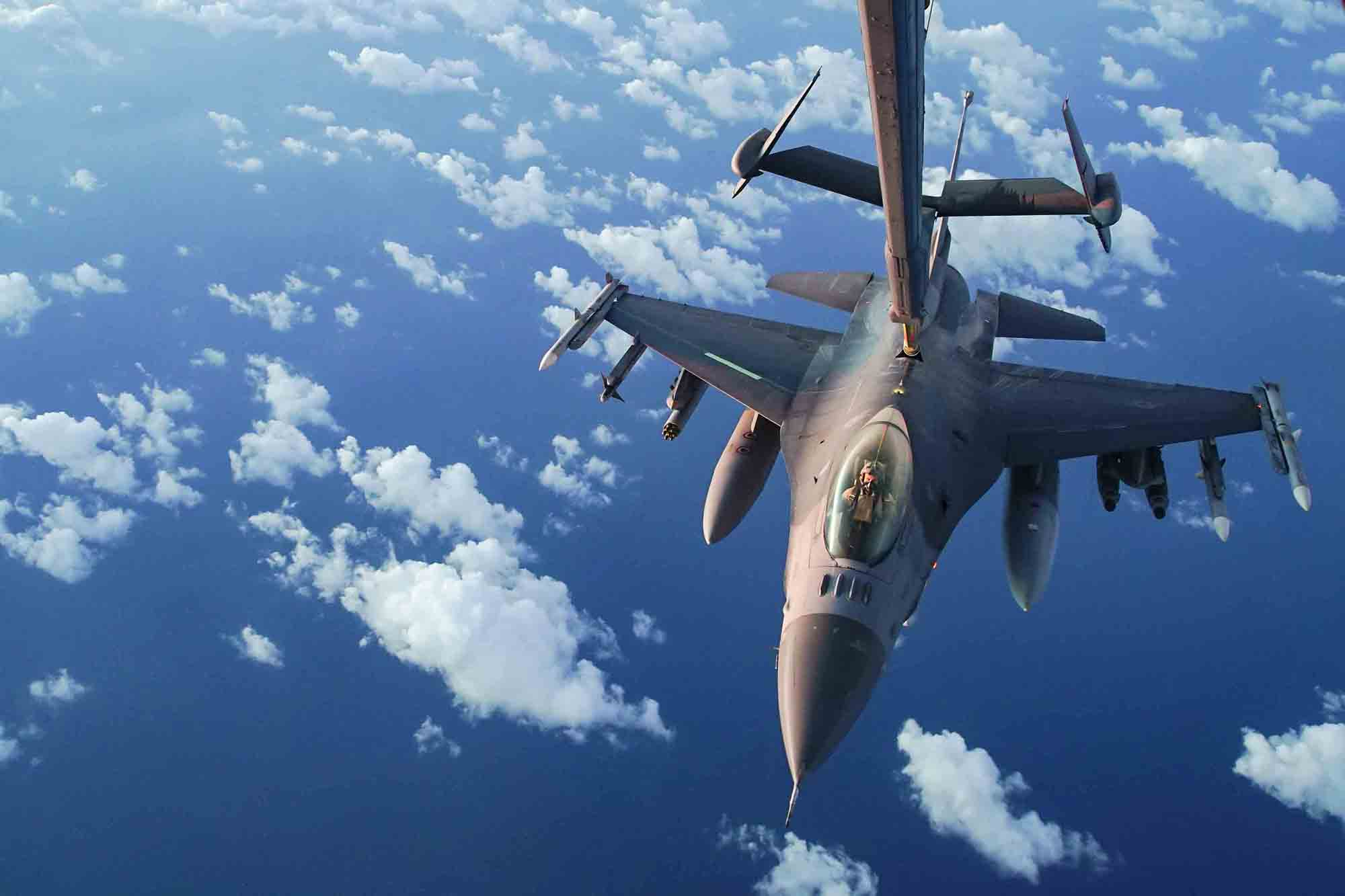 A U.S. Air Force F-16 Fighting Falcon receives fuel from a U.S. Air Force KC-10 Extender during an n-air refueling mission supporting Operation Octave Quartz with armed over-watch in Africa, Jan. 9, 2020. (Staff Sgt. Taylor Harrison/Air Force)