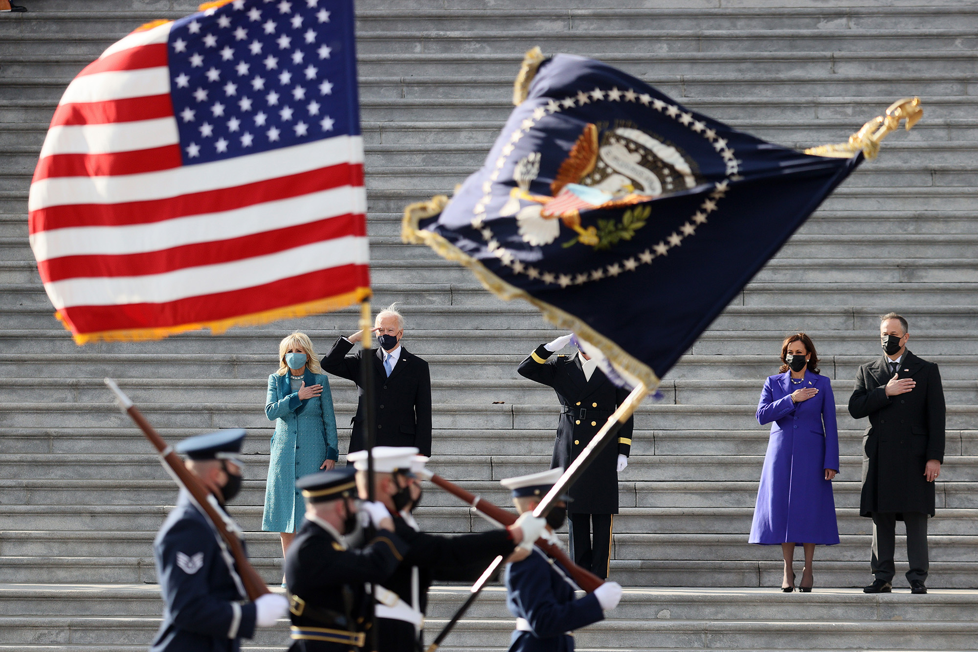 President Joe Biden, first lady Dr. Jill Biden, Vice President Kamala Harris and Douglas Emhoff, husband of Vice President Harris, attend a Pass-in-Review ceremony, hosted by the Joint Task Force-National Capital Region on the East Front of the U.S. Capitol after the 59th Presidential Inauguration on Jan. 20, 2021 in Washington. (Joe Raedle/Getty Images)