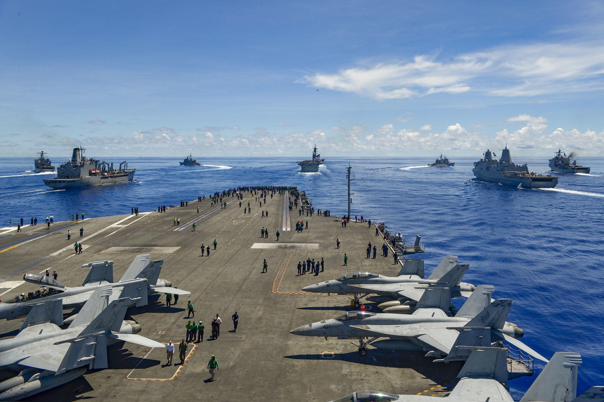 From left: USS Germantown (LSD 42), USNS John Ericsson (T-AO 194), USS Antietam (CG 54), USS Ronald Reagan (CVN 76), USS America (LHA 6), USS Shiloh (CG 67), USS New Orleans (LPD 18), and USS Comstock (LSD 45) break away from formation in support of Valiant Shield 2020 on Sept. 25, 2020, in the Philippine Sea. (Mass Communication Specialist Seaman Apprentice Oswald Felix Jr./Navy)