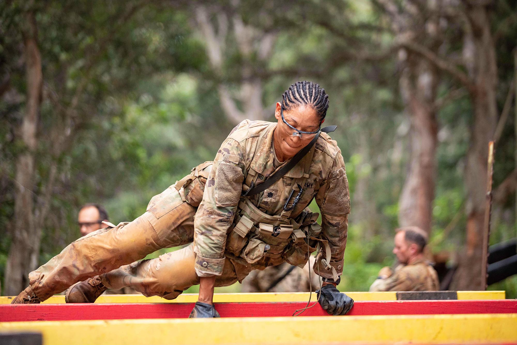 Lt. Col. Paula Young, Brigade Surgeon, 25th Infantry Division Sustainment Brigade, hurdles over an obstacle during the Green Mile, a physical endurance course that concludes the final week of Jungle Operations Training Course at East Range, Hawaii, on Oct. 1, 2020. (1st Lt. Angelo Mejia/Army)