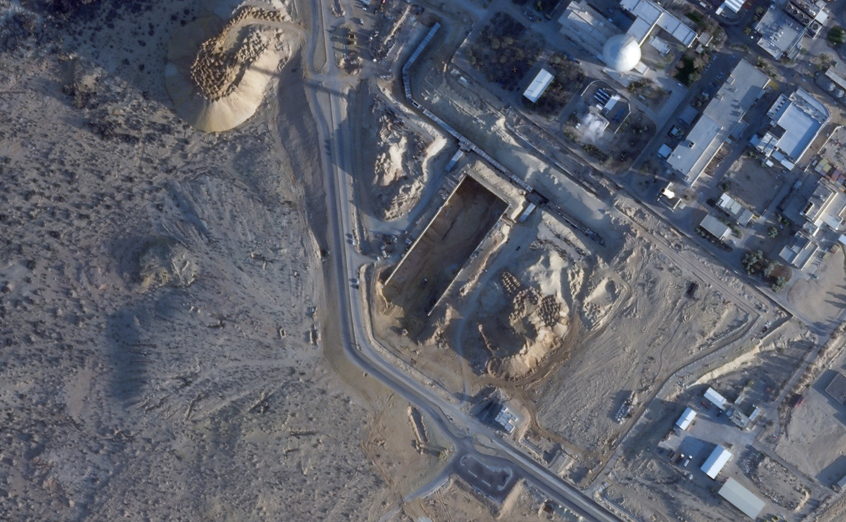 This Feb. 22, 2021, satellite photo shows construction near the Shimon Peres Negev Nuclear Research Center, not far from the city of Dimona, Israel. A long-secretive Israeli nuclear facility that gave birth to its undeclared atomic weapons program is undergoing what appears to be its biggest construction project in decades, according to analysis by AP. (Planet Labs Inc. via AP)