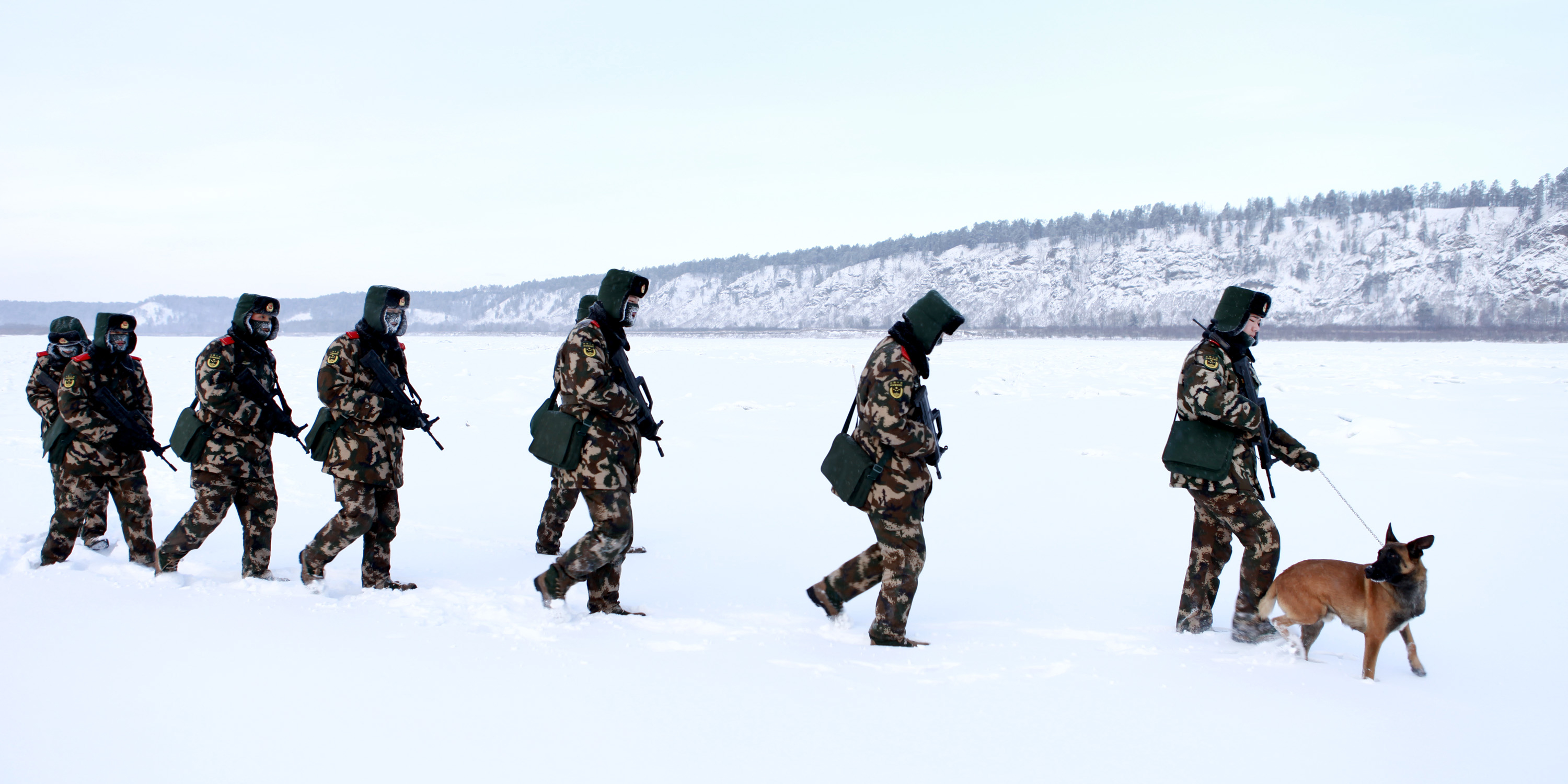 Chinese paramilitary police border guards train in the snow at Mohe County in China's northeast Heilongjiang province, on the border with Russia, on Dec. 12, 2016. Mohe is the northernmost point in China, with a subarctic climate. (STR/AFP via Getty Images)