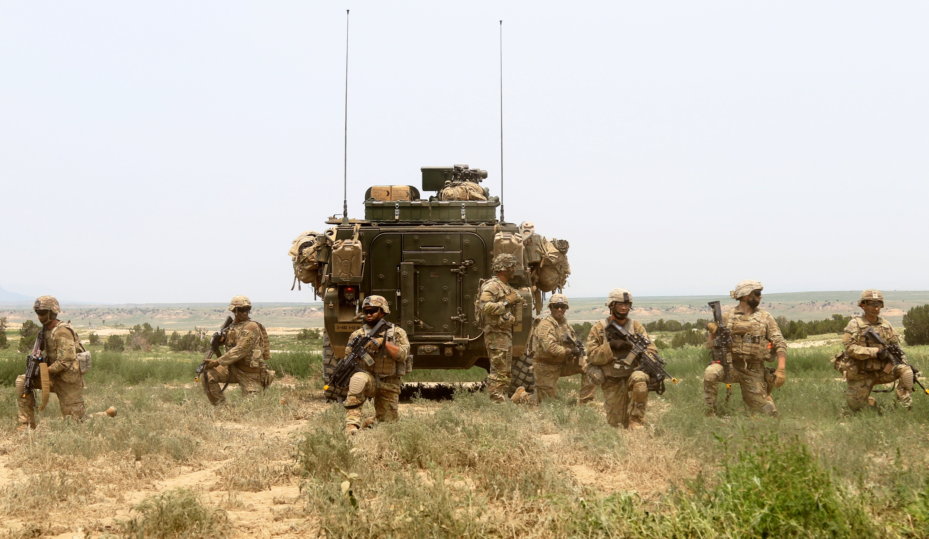 Soldiers with 1st Battalion, 12th Infantry Regiment, 2nd Stryker Brigade Combat Team, 4th Infantry Division, pull security during a platoon live-fire exercise July 12 at Fort Carson, Colo. The Warhorse Brigade's training aligns with its upcoming training rotation to Fort Irwin, Calif. (Maj. Jason Elmore/Army)